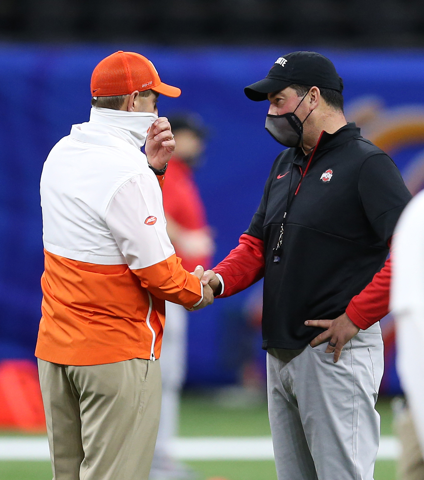 Clemson Tigers head coach Dabo Swinney meets with Ohio State Buckeyes head coach Ryan Day prior to the game at Mercedes-Benz Superdome.