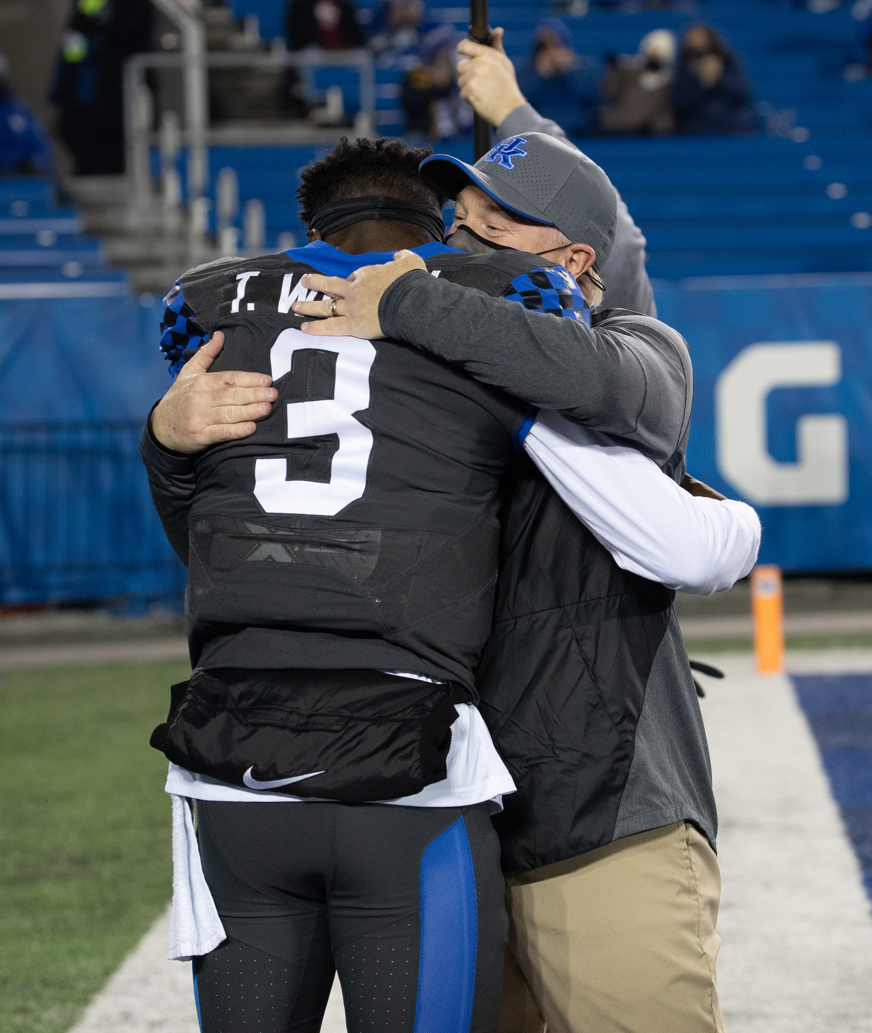 Terry Wilson #3 of the Kentucky Wildcats hugs head coach Mark Stoops before the game against the South Carolina Gamecocks at Kroger Field on December 5, 2020 in Lexington, Kentucky.
