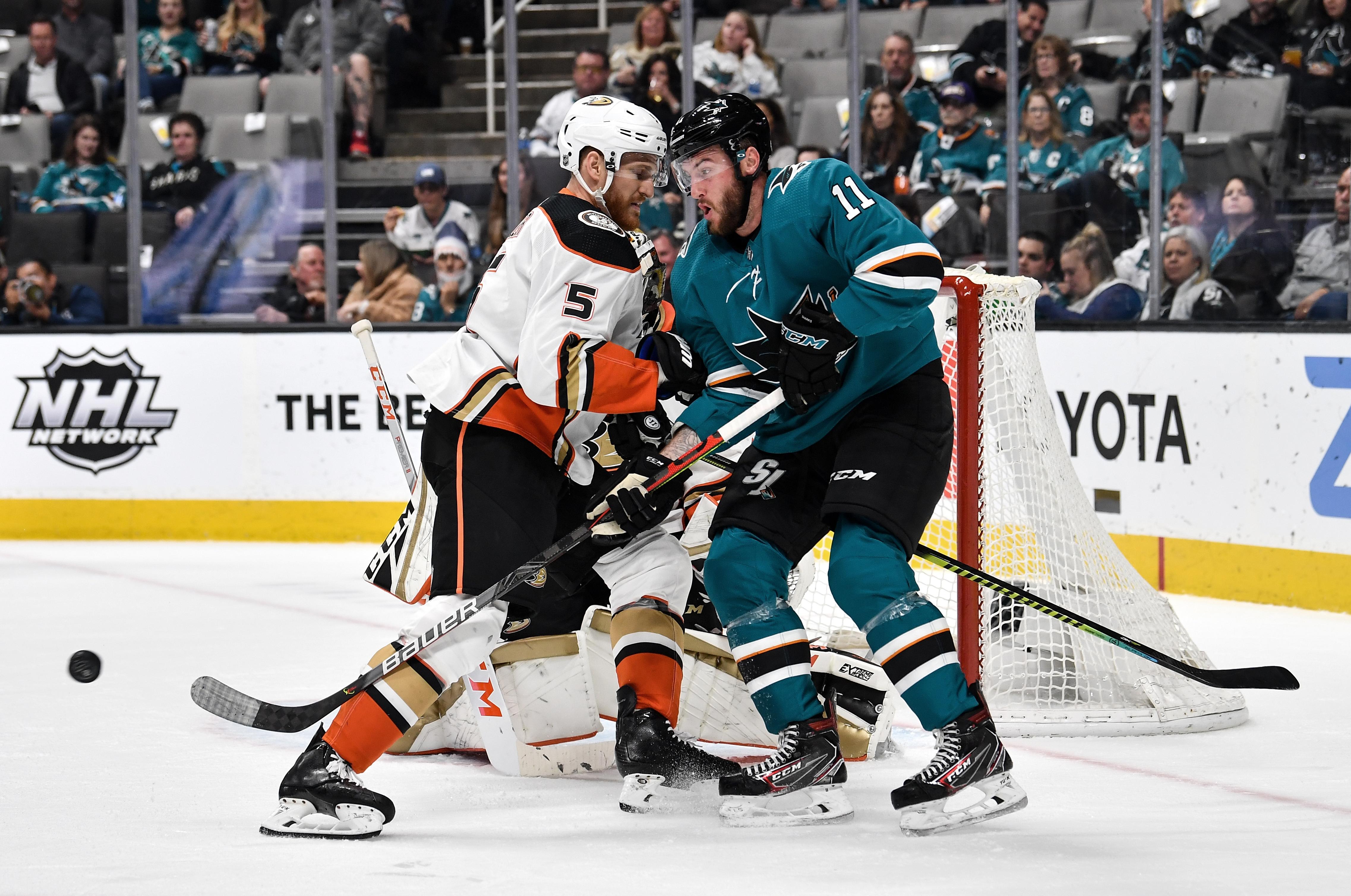 Stefan Noesen #11 of the San Jose Sharks battles for the puck against Korbinian Holzer #5 of the Anaheim Ducks at SAP Center on January 27, 2020 in San Jose, California
