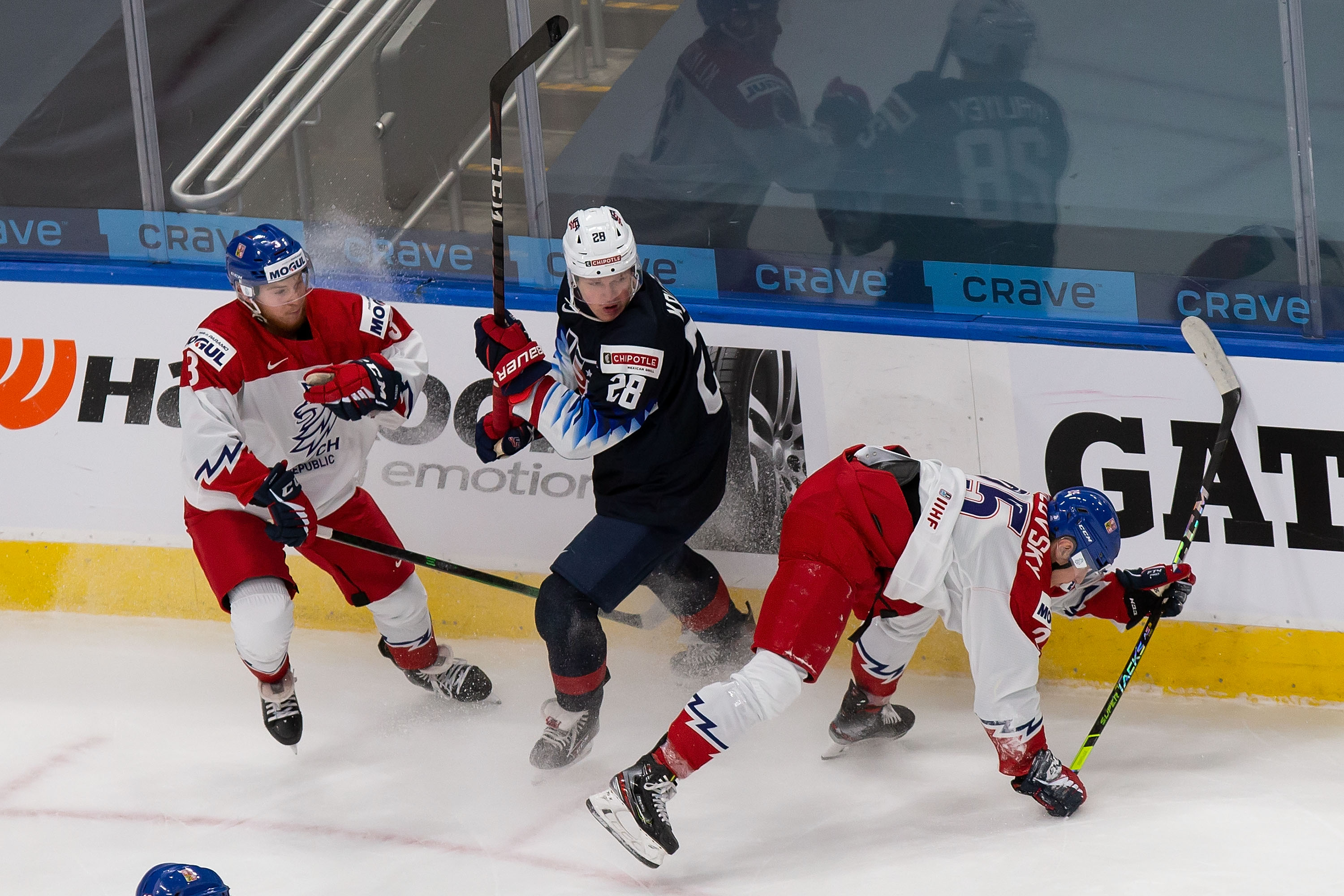 Arthur Kaliyev #28 of the United States skates against Karel Klikorka #3 and Jakub Rychlovsky #25 of the Czech Republic during the 2021 IIHF World Junior Championship at Rogers Place on December 29, 2020 in Edmonton, Canada.