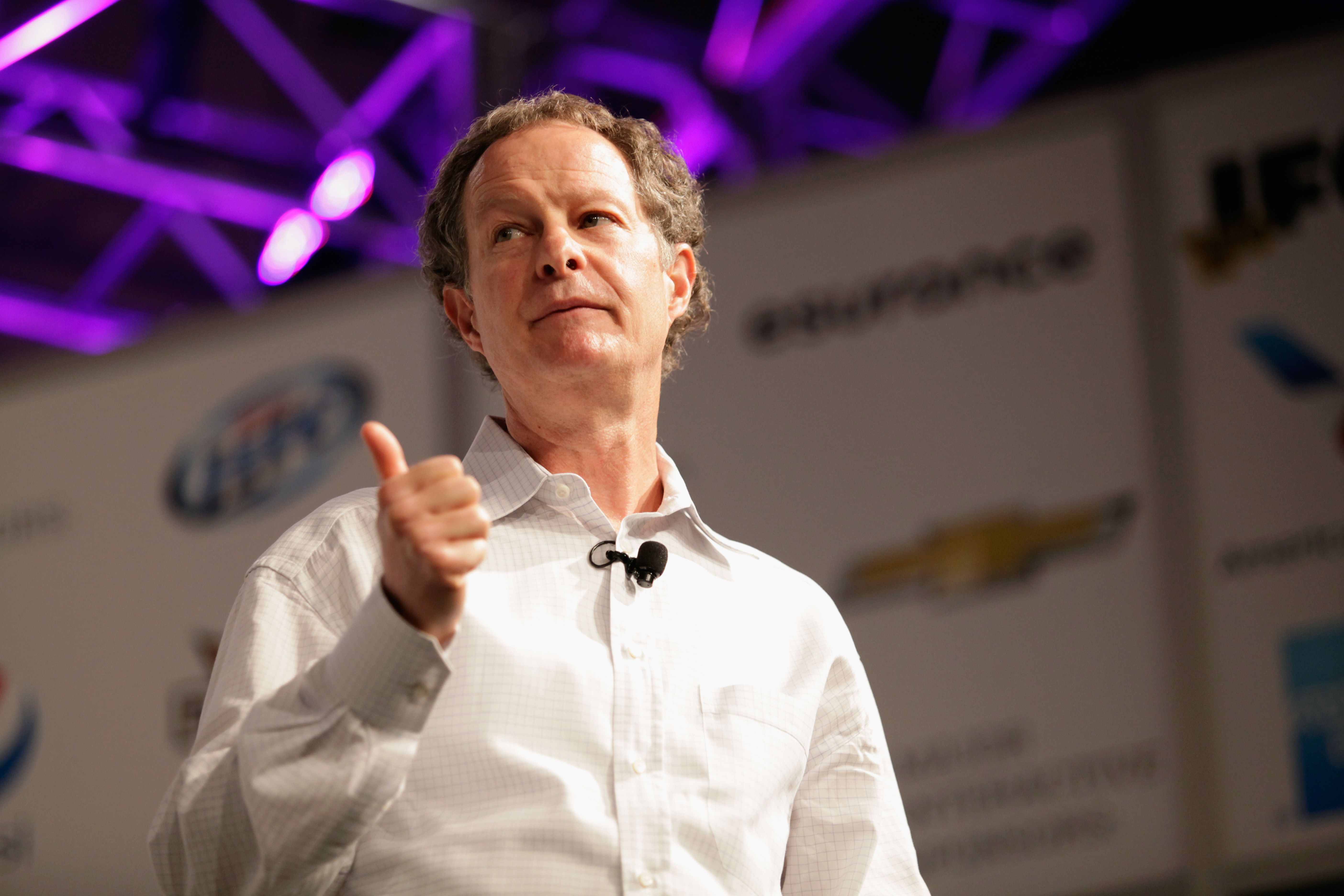 CEO of Whole Foods Market John Mackey giving a thumbs up