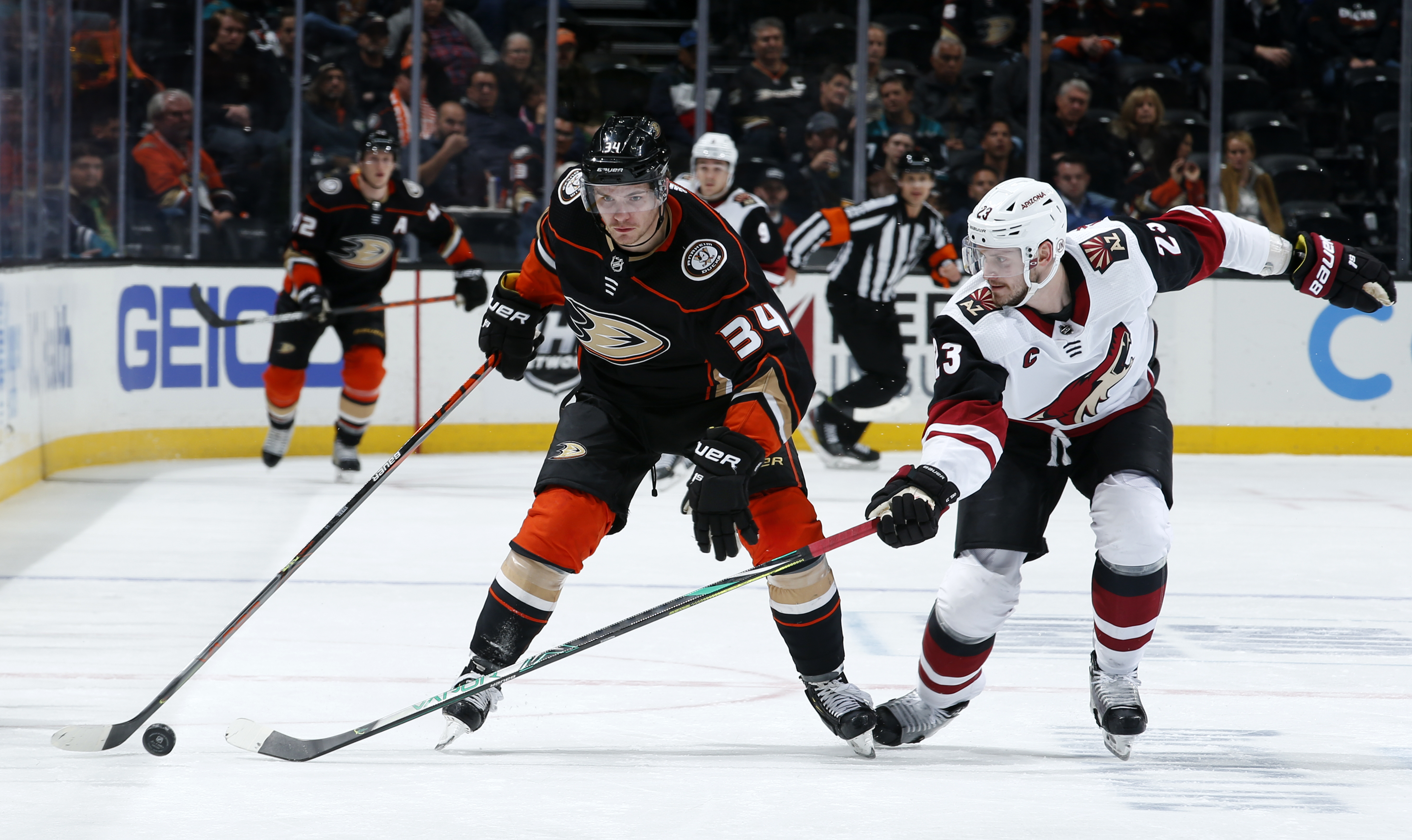 Sam Steel #34 of the Anaheim Ducks skates with the puck with pressure from Oliver Ekman-Larsson #23 of the Arizona Coyotes during the game at Honda Center on January 29, 2020 in Anaheim, California.