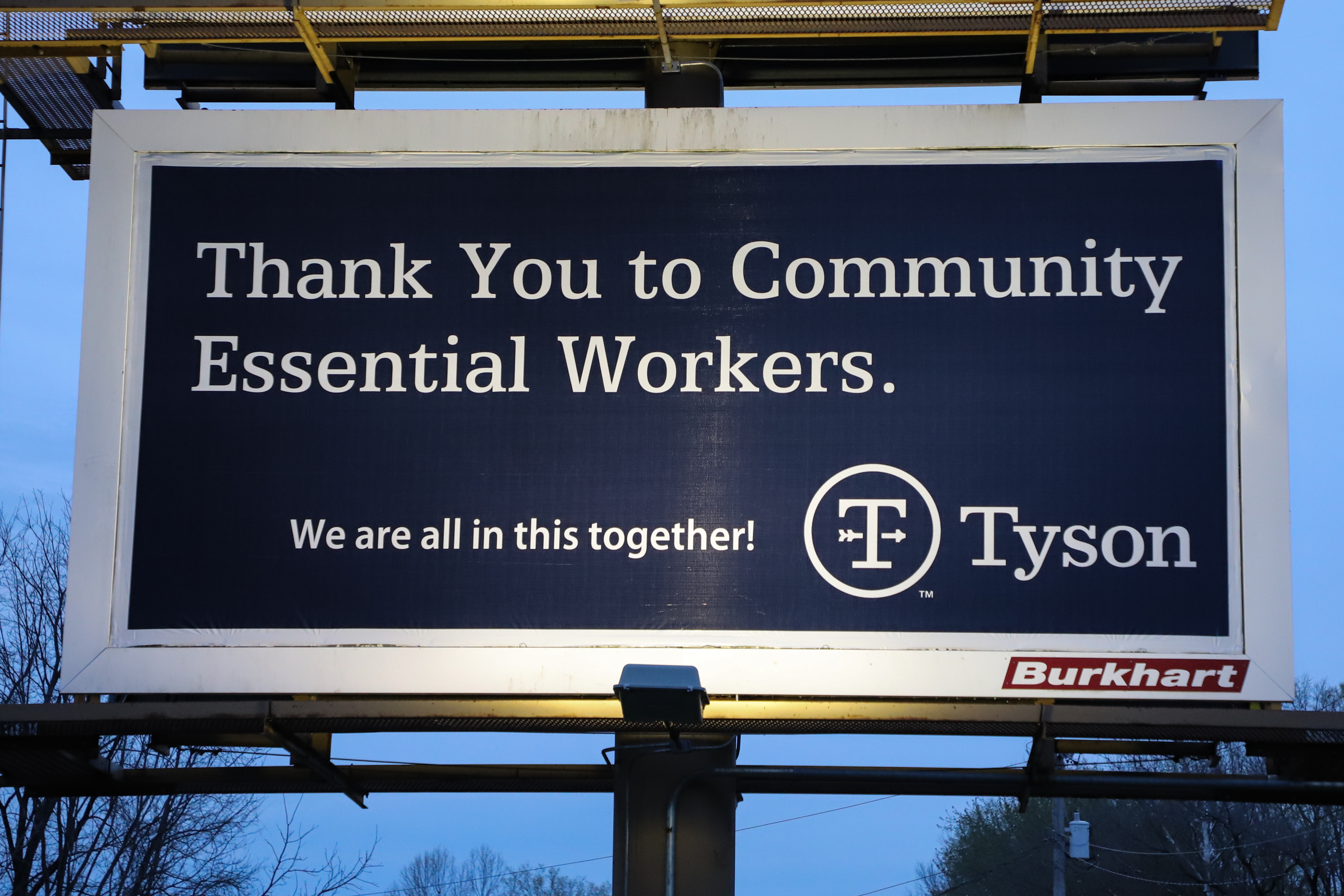 """A billboard with the text: """"Thank you to community essential workers. We're all in this together."""" from Tyson Foods"""