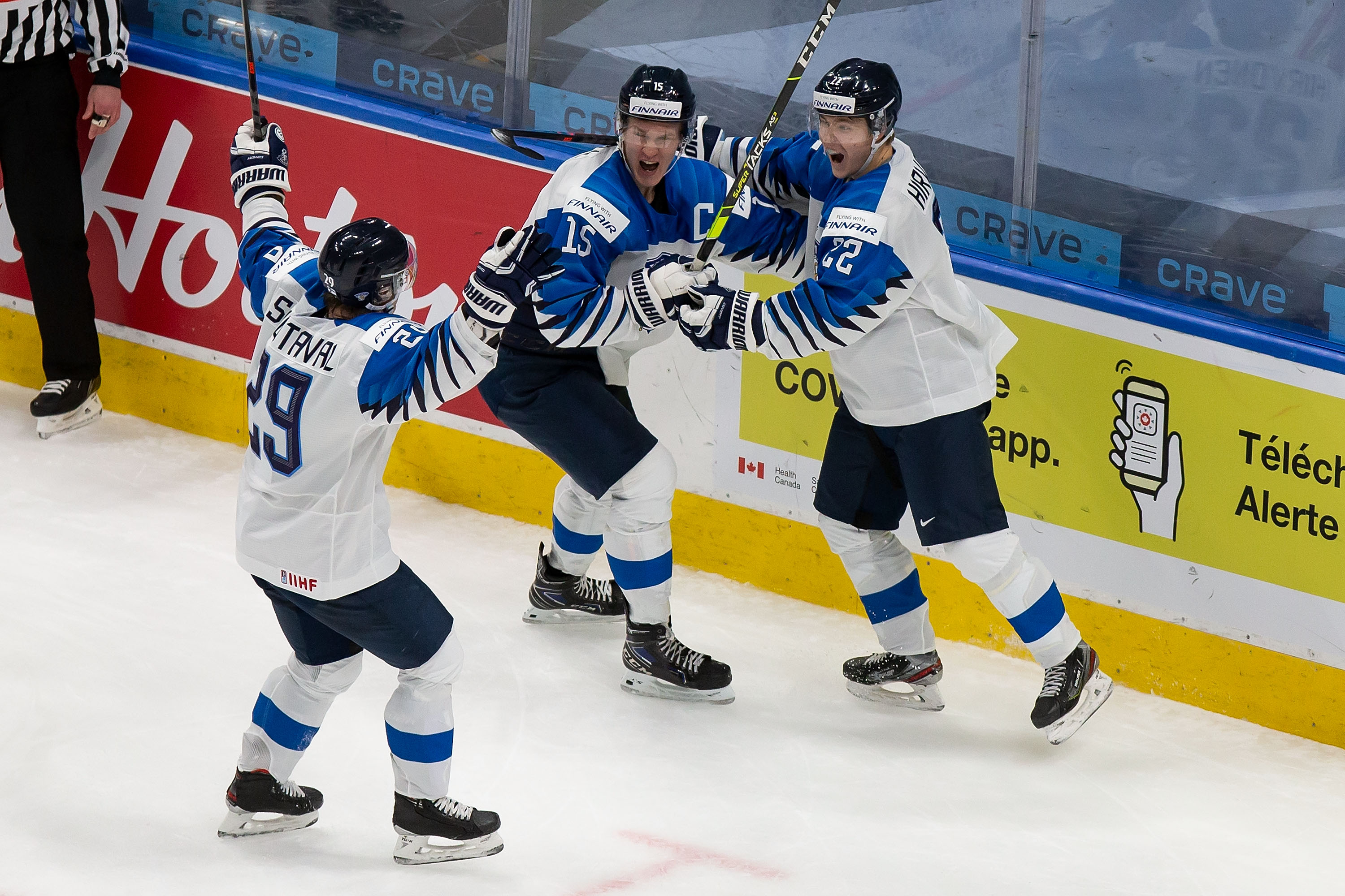 Kasper Simontaival #29, Anton Lundell #15 and Roni Hirvonen #22 of Finland celebrate a goal against the United States during the 2021 IIHF World Junior Championship semifinals at Rogers Place on January 4, 2021 in Edmonton, Canada.