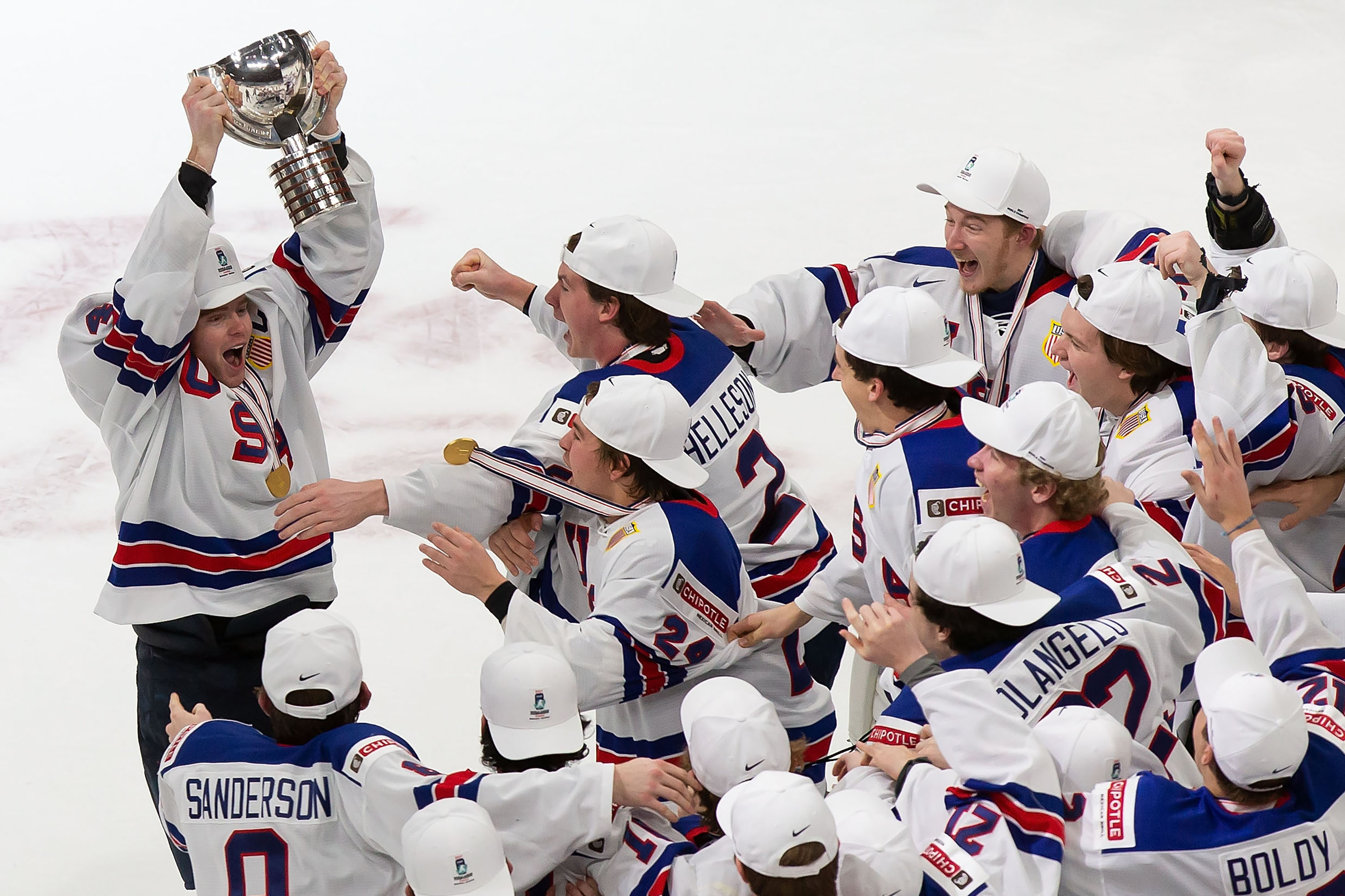 Cam York #4 of the United States hoists the World Junior Championship trophy after beating Canada during the 2021 IIHF World Junior Championship gold medal game at Rogers Place on January 5, 2021 in Edmonton, Canada.