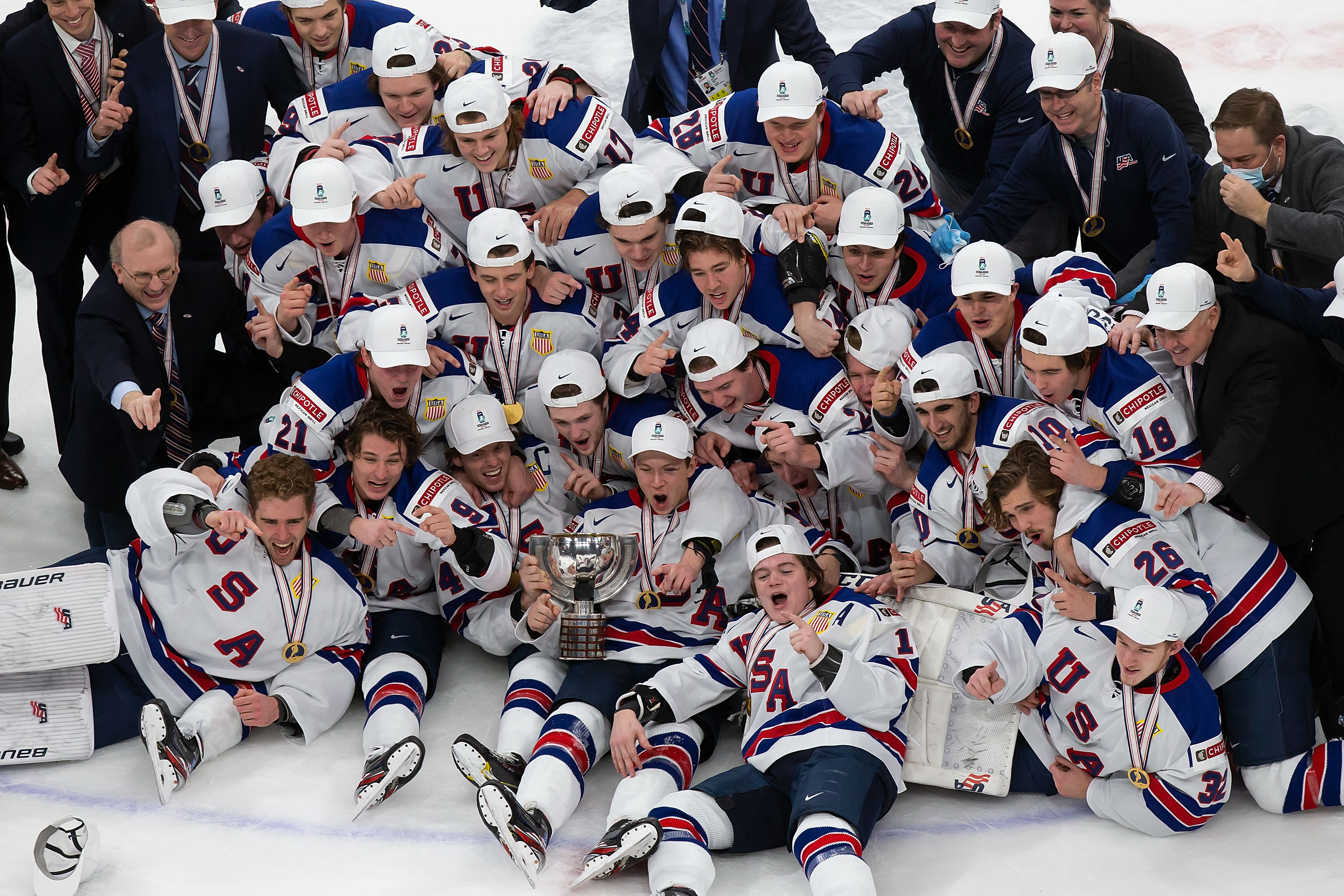 The United States team celebrates its victory over Canada during the 2021 IIHF World Junior Championship gold medal game at Rogers Place on January 5, 2021 in Edmonton, Canada.