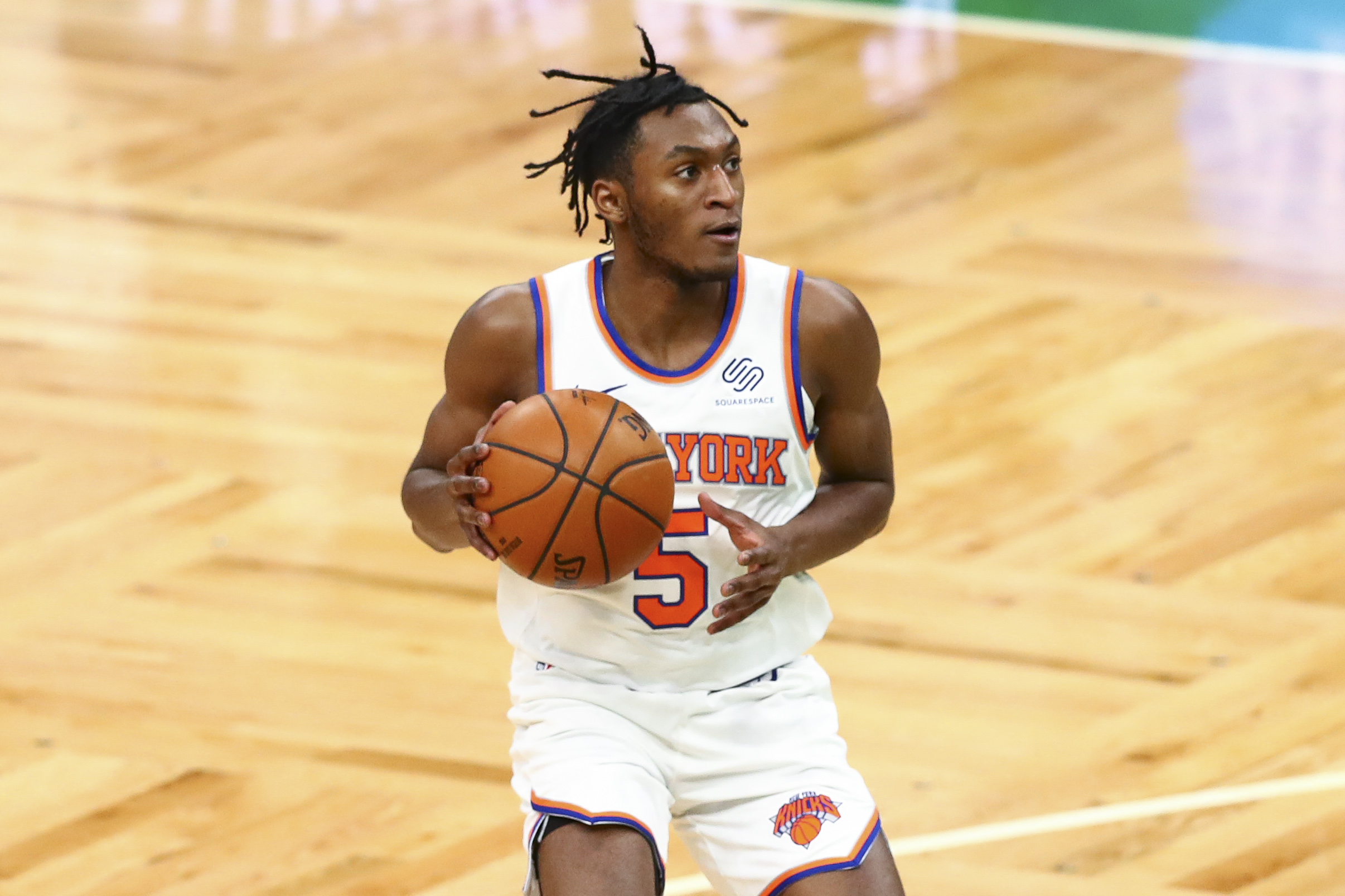 Immanuel Quickley of the New York Knicks looks to pass during a game against the Boston Celtics at TD Garden on January 17, 2021 in Boston, Massachusetts.
