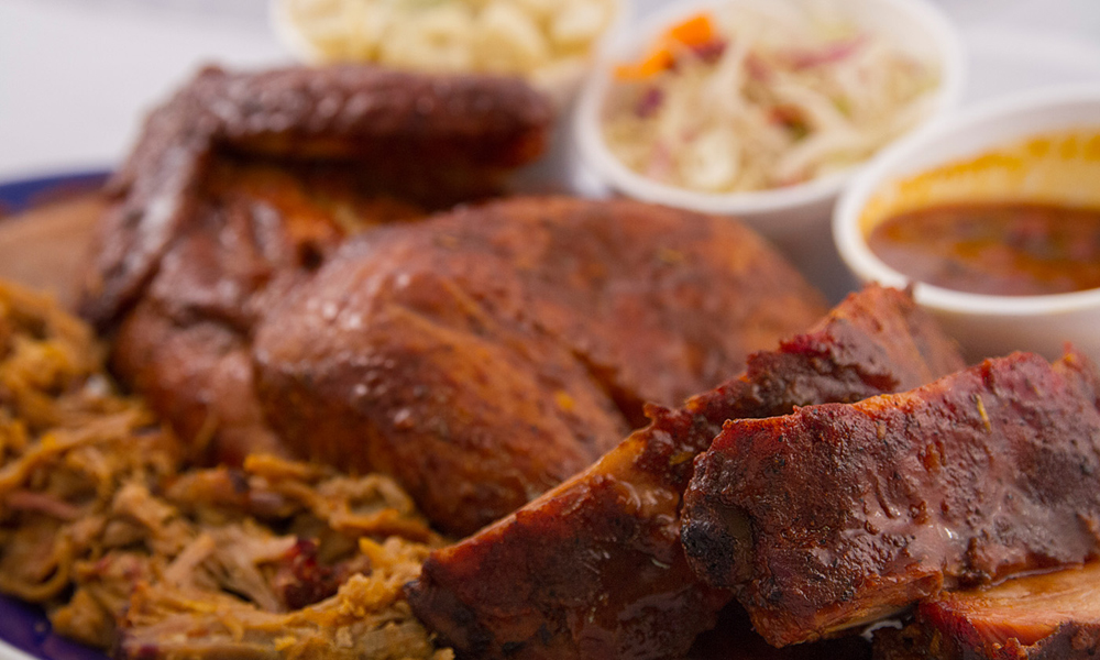 A plate of barbecue ribs, chicken, rice and beans a specialty of the SNS Diner.
