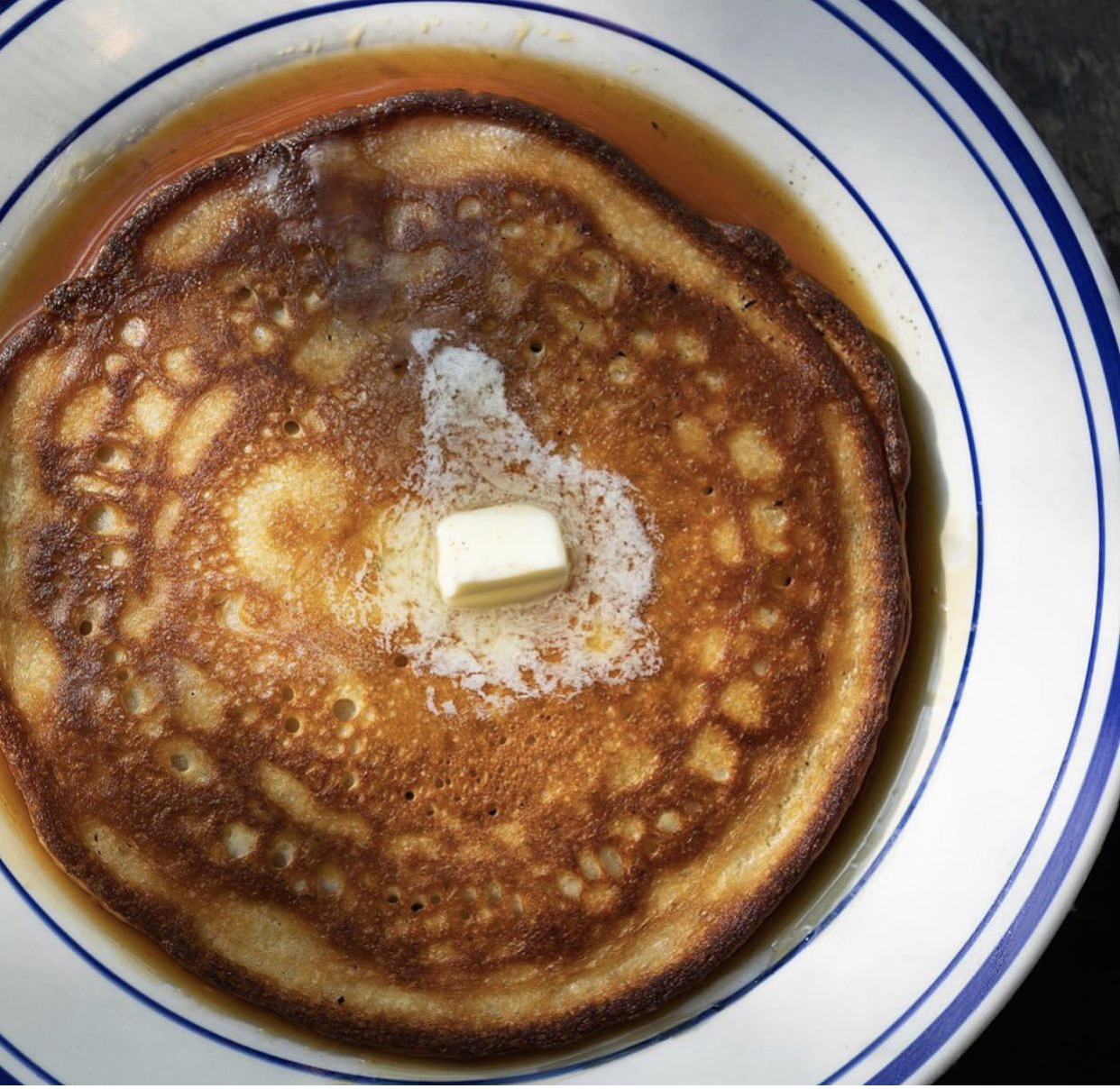 up close photo of a pancake with butter on top