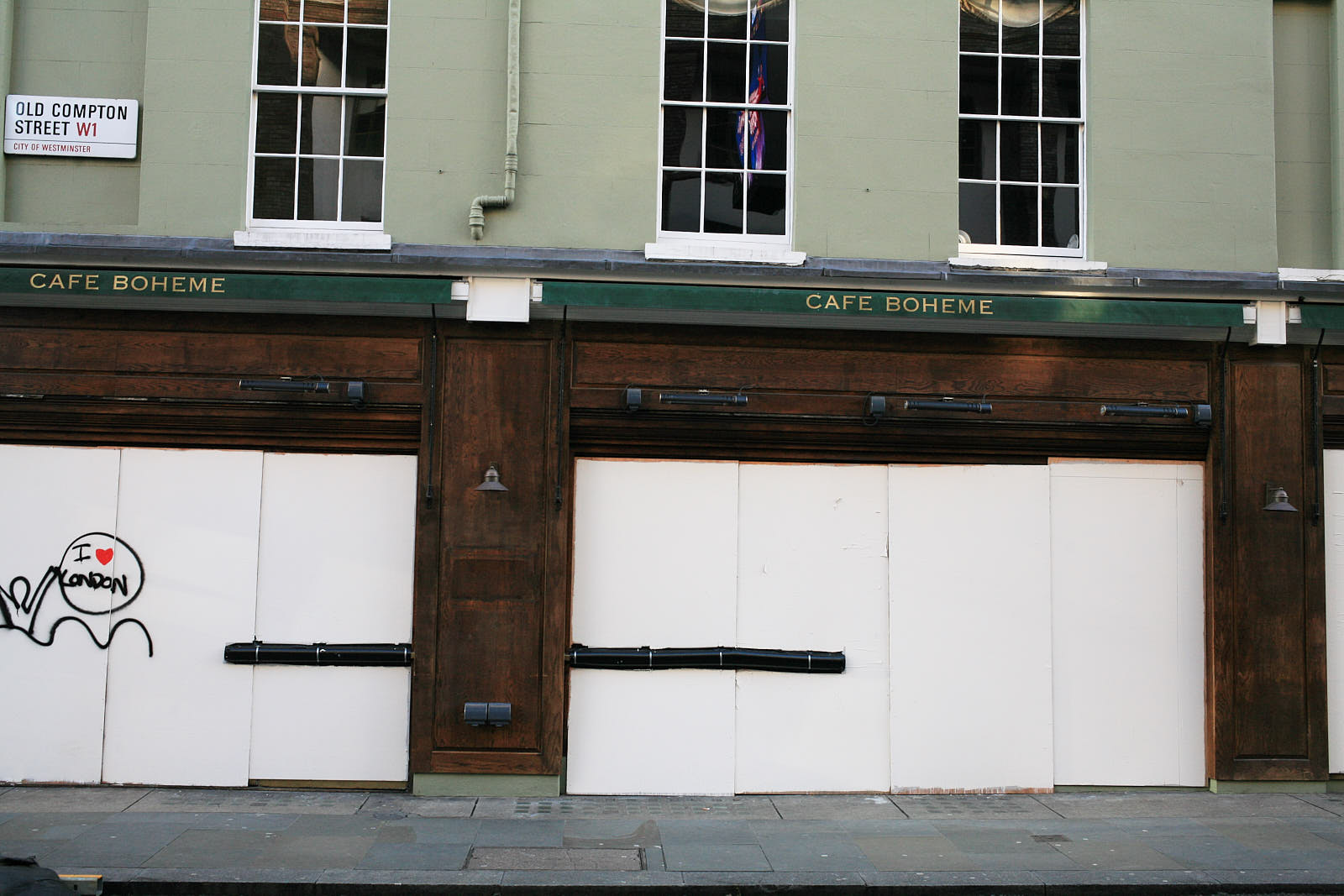 Cafe Boheme in Soho boarded up at the beginning of 2021