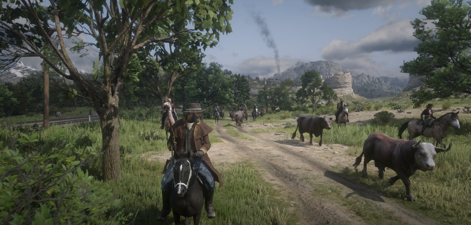 Red Dead Online - players, dressed as cowboys and riding horses, on a private server escort bovine down a dirt road