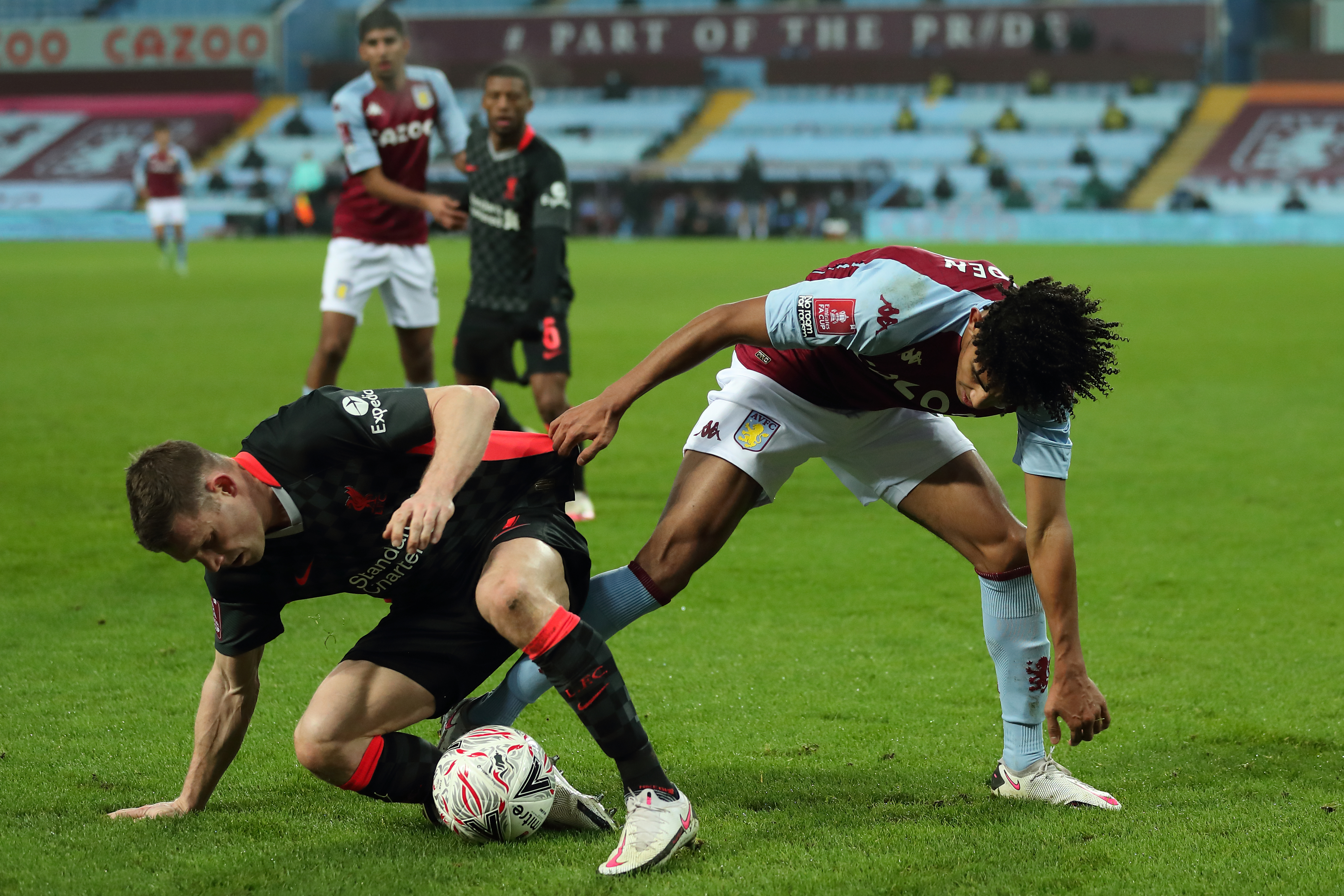 James Milner of Liverpool and Kaine Hayden of Aston Villa during the FA Cup Third Round match between Aston Villa and Liverpool at Villa Park on January 8, 2021 in Birmingham, England.