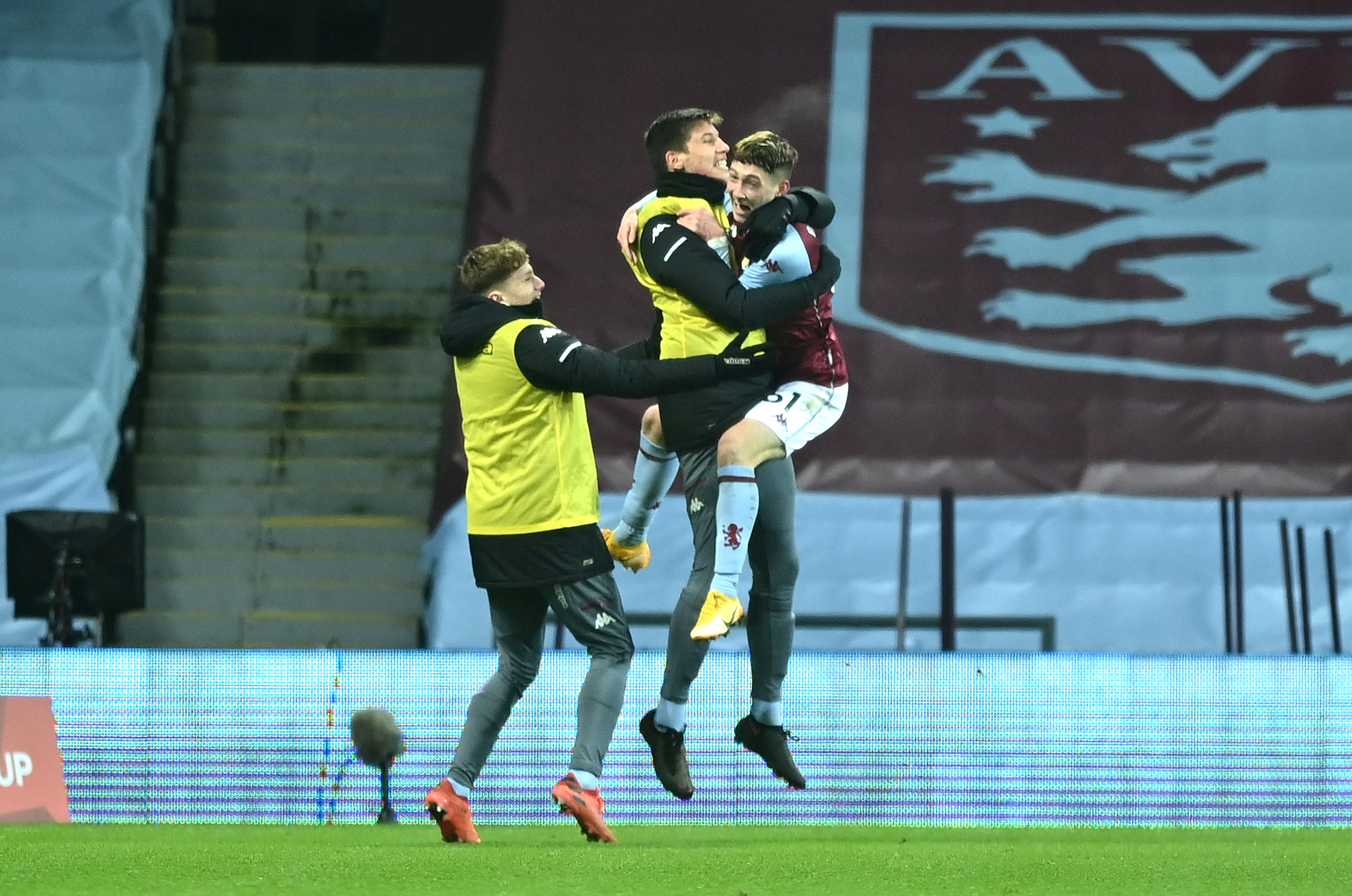 Louie Barry of Aston Villa celebrates after scoring their sides first goal with players from the bench during the FA Cup Third Round match between Aston Villa and Liverpool at Villa Park on January 08, 2021 in Birmingham, England.