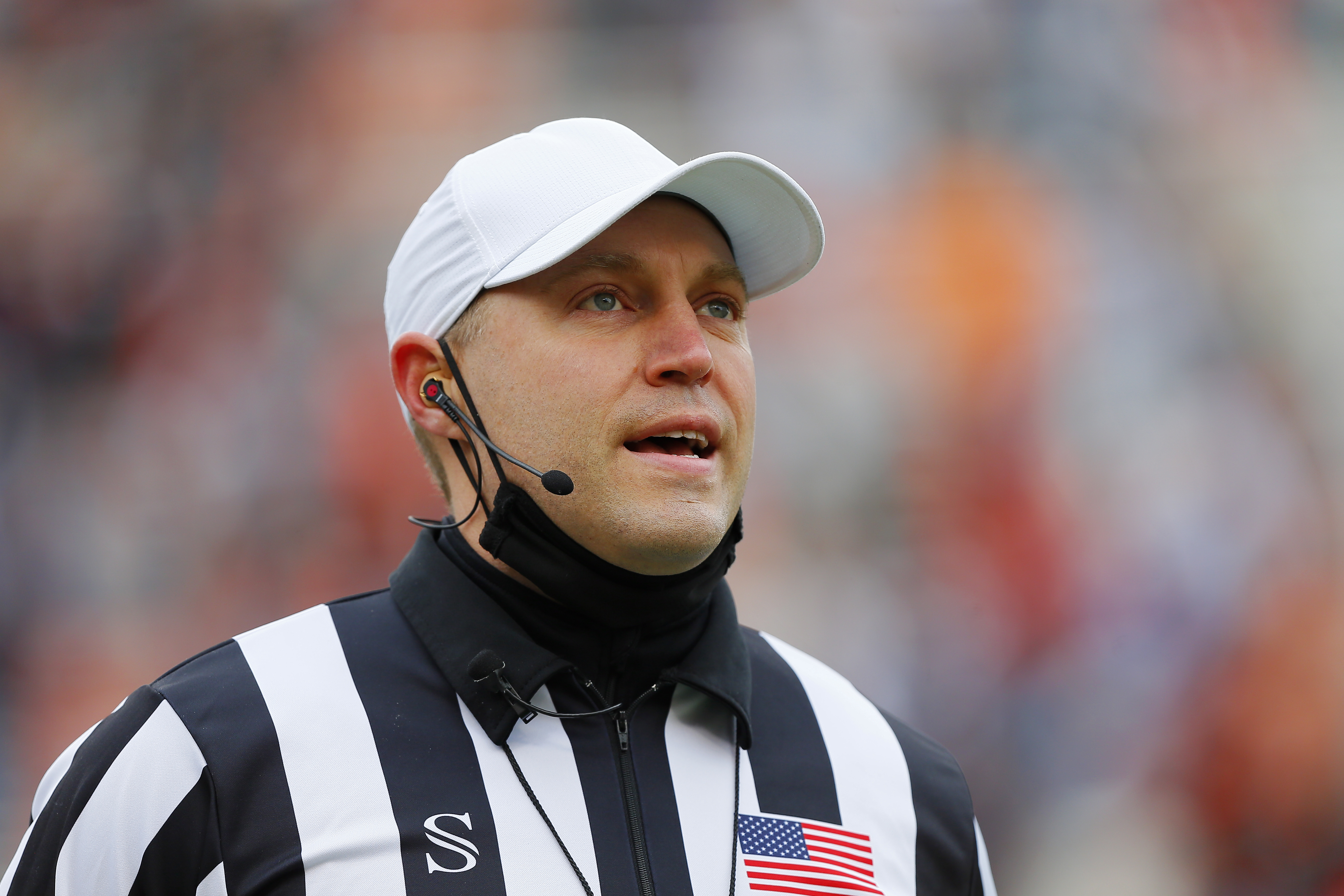 Referee Brandon Cruse announces the result of a review of a pass by the Oklahoma State Cowboys where the ball was dropped in the end zone against the Texas Tech Red Raiders in the first quarter at Boone Pickens Stadium on November 28, 2020 in Stillwater, Oklahoma. OSU won 50-44.