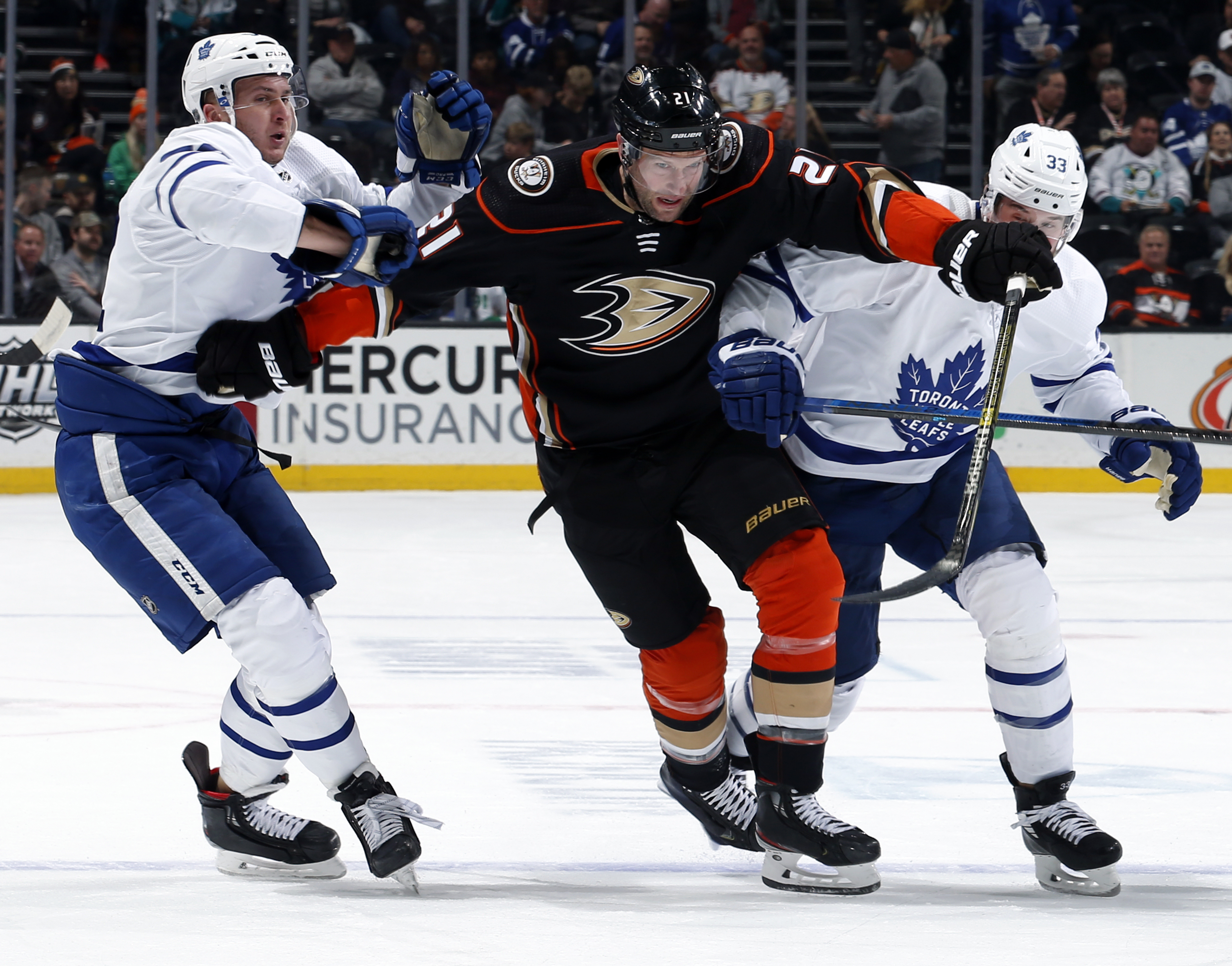 ANAHEIM, CA - MARCH 6: David Backes #21 of the Anaheim Ducks battles for position against Martin Marincin #52 and Frederik Gauthier #33 of the Toronto Maple Leafs during the game at Honda Center on March 6, 2020 in Anaheim, California.