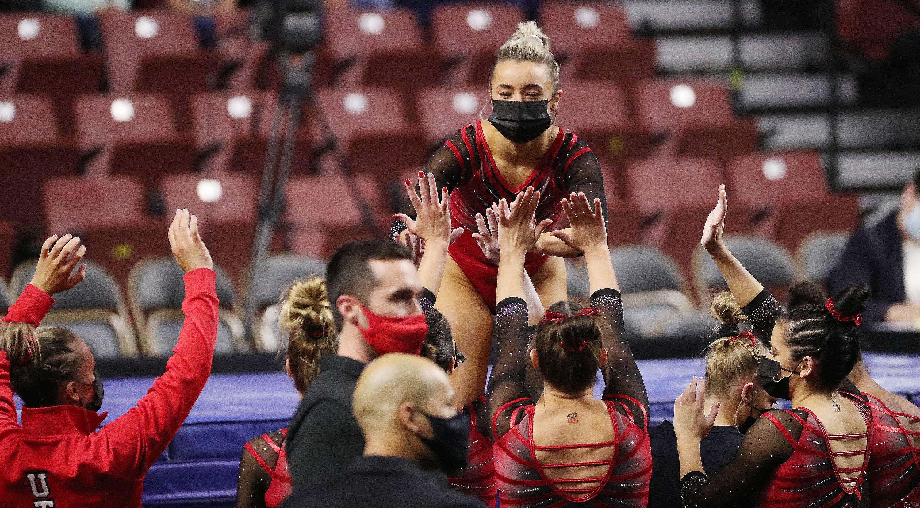 Utah's Abby Paulson reacts with teammates after competing on the beam during the Rio Tinto Best of Utah NCAA gymnastics meet at the Maverik Center in West Valley City on Saturday, Jan. 9, 2021.