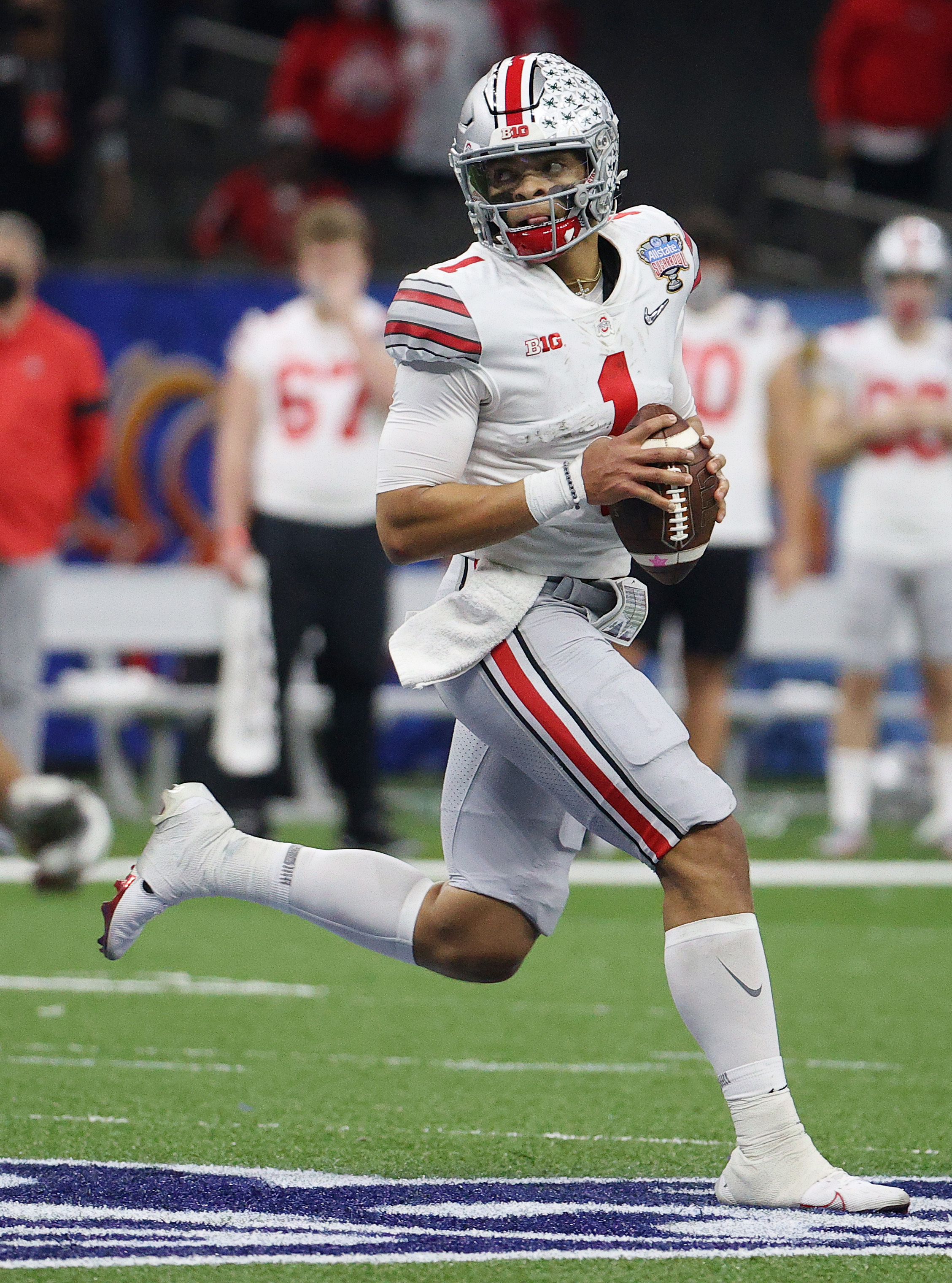 Justin Fields of the Ohio State Buckeyes looks to pass in the first half against the Clemson Tigers during the College Football Playoff semifinal game at the Allstate Sugar Bowl at Mercedes-Benz Superdome on January 01, 2021 in New Orleans, Louisiana.