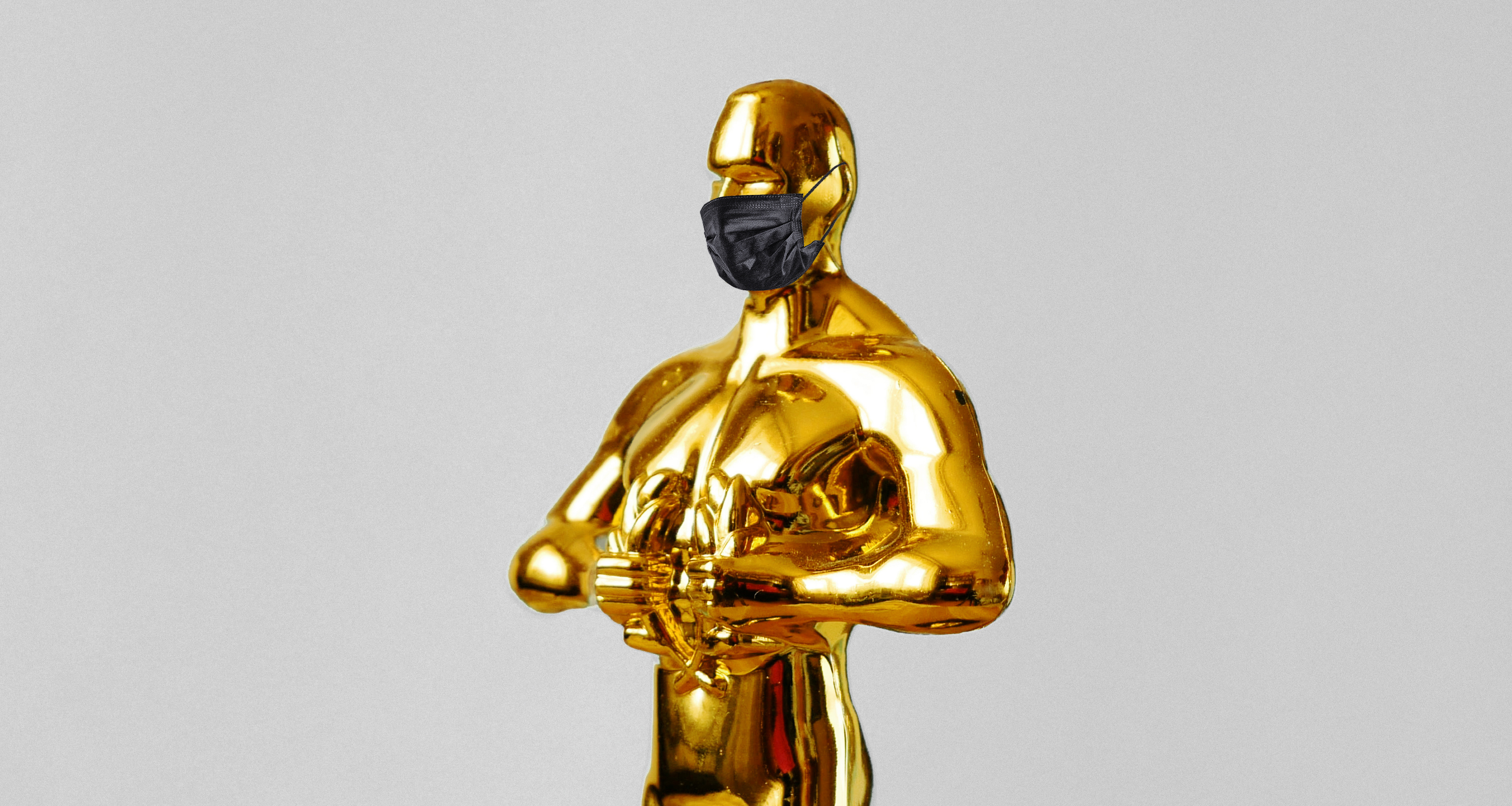 An Oscar statuette wearing a surgical mask.