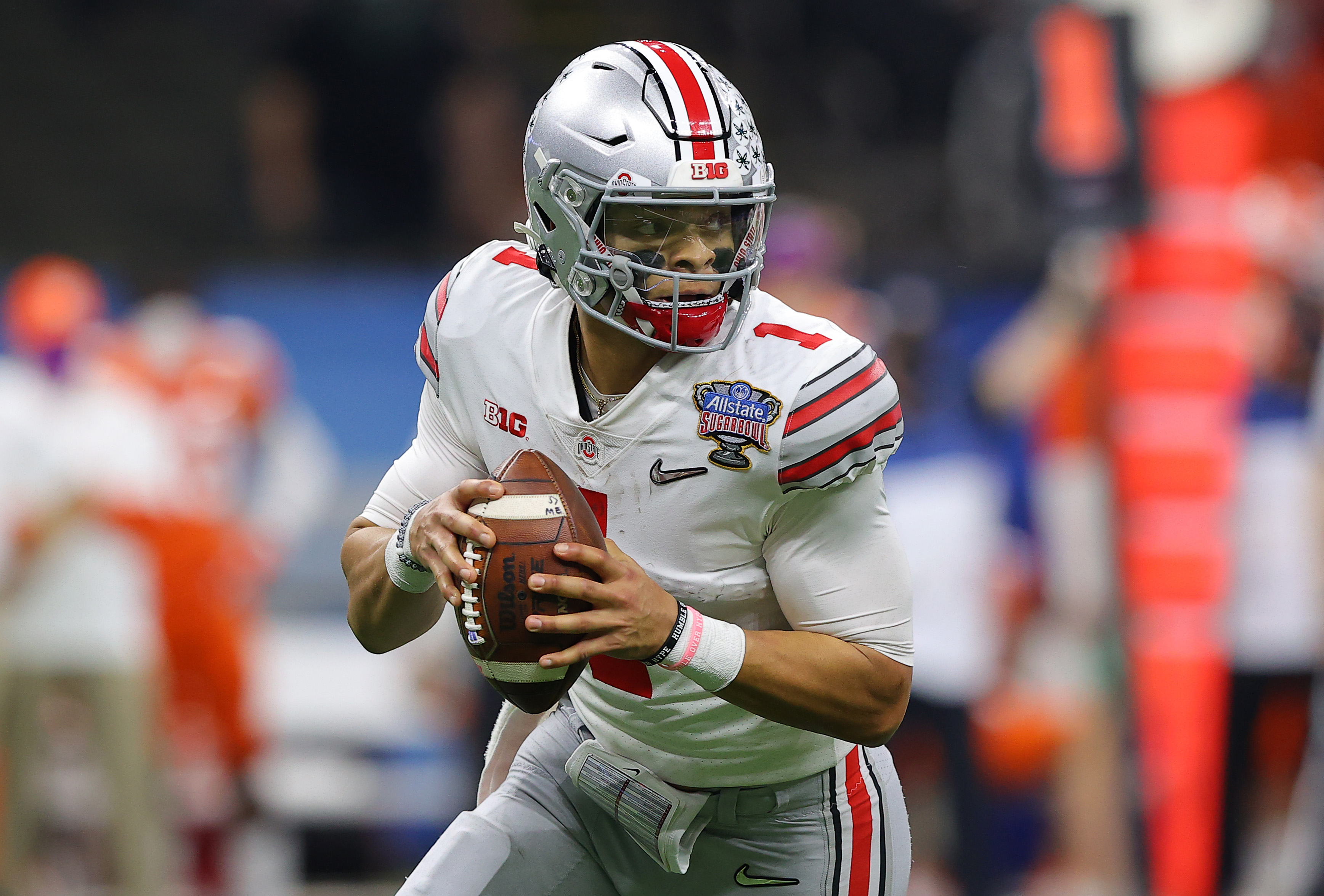 Justin Fields #1 of the Ohio State Buckeyes looks to pass against the Clemson Tigers in the first half during the College Football Playoff semifinal game at the Allstate Sugar Bowl at Mercedes-Benz Superdome on January 01, 2021 in New Orleans, Louisiana.