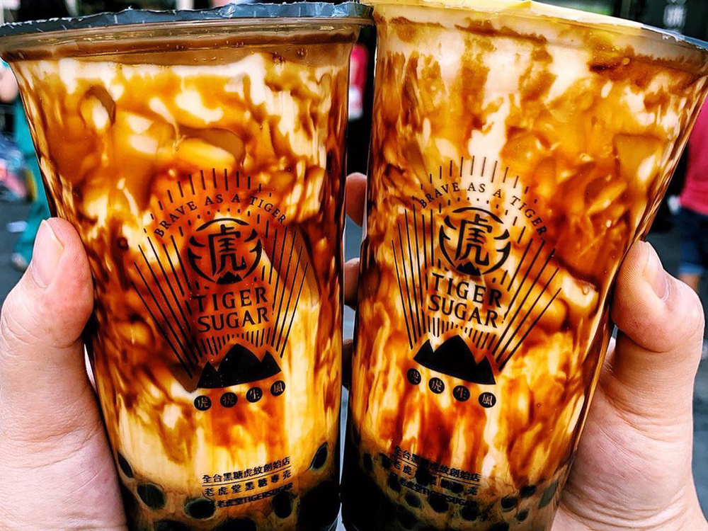 Two cups of striped brown sugar bubble tea from Tiger Sugar, coming soon to Henderson.