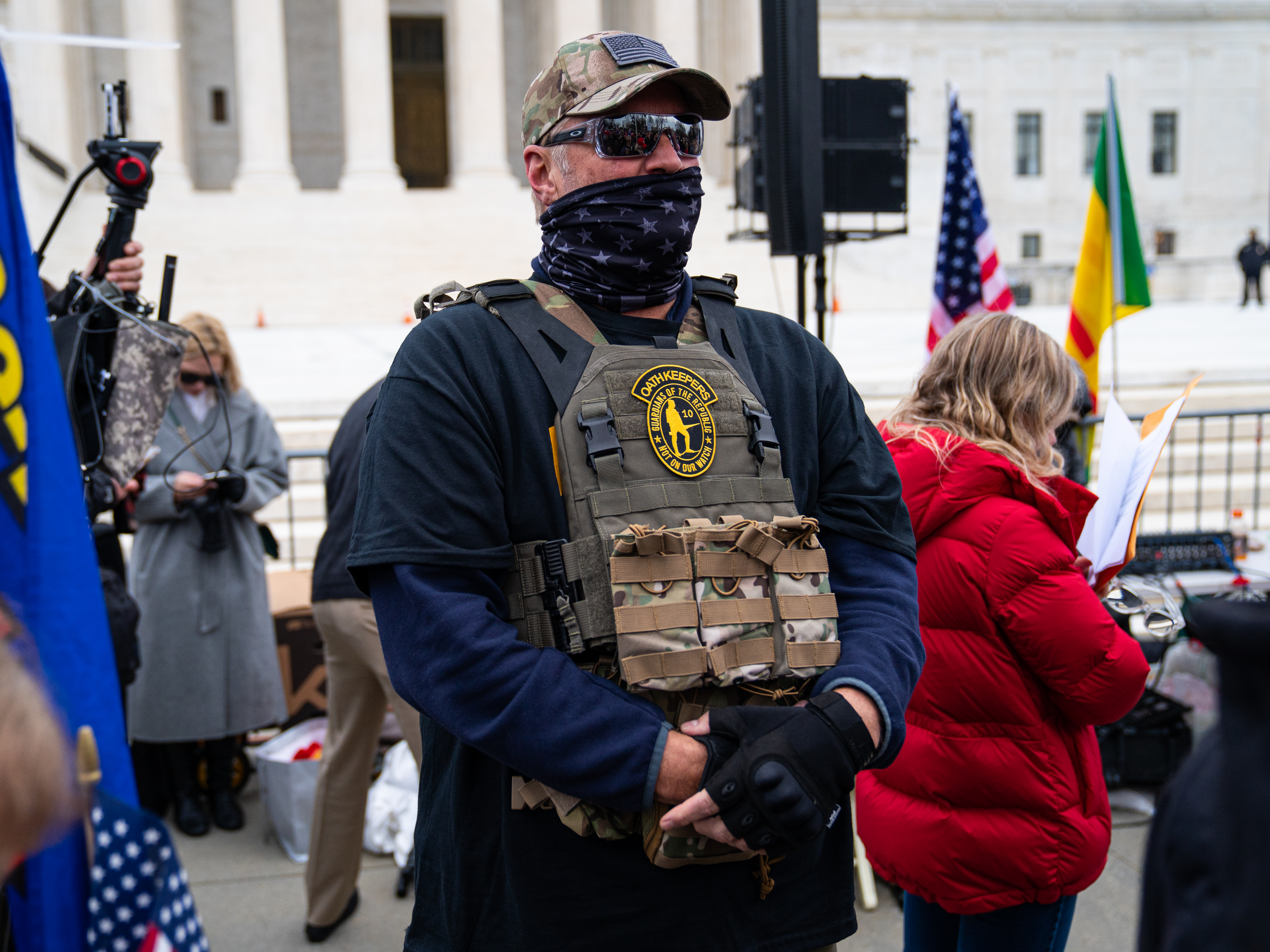 A person wearing military-style gear at a Washington, DC, rally.