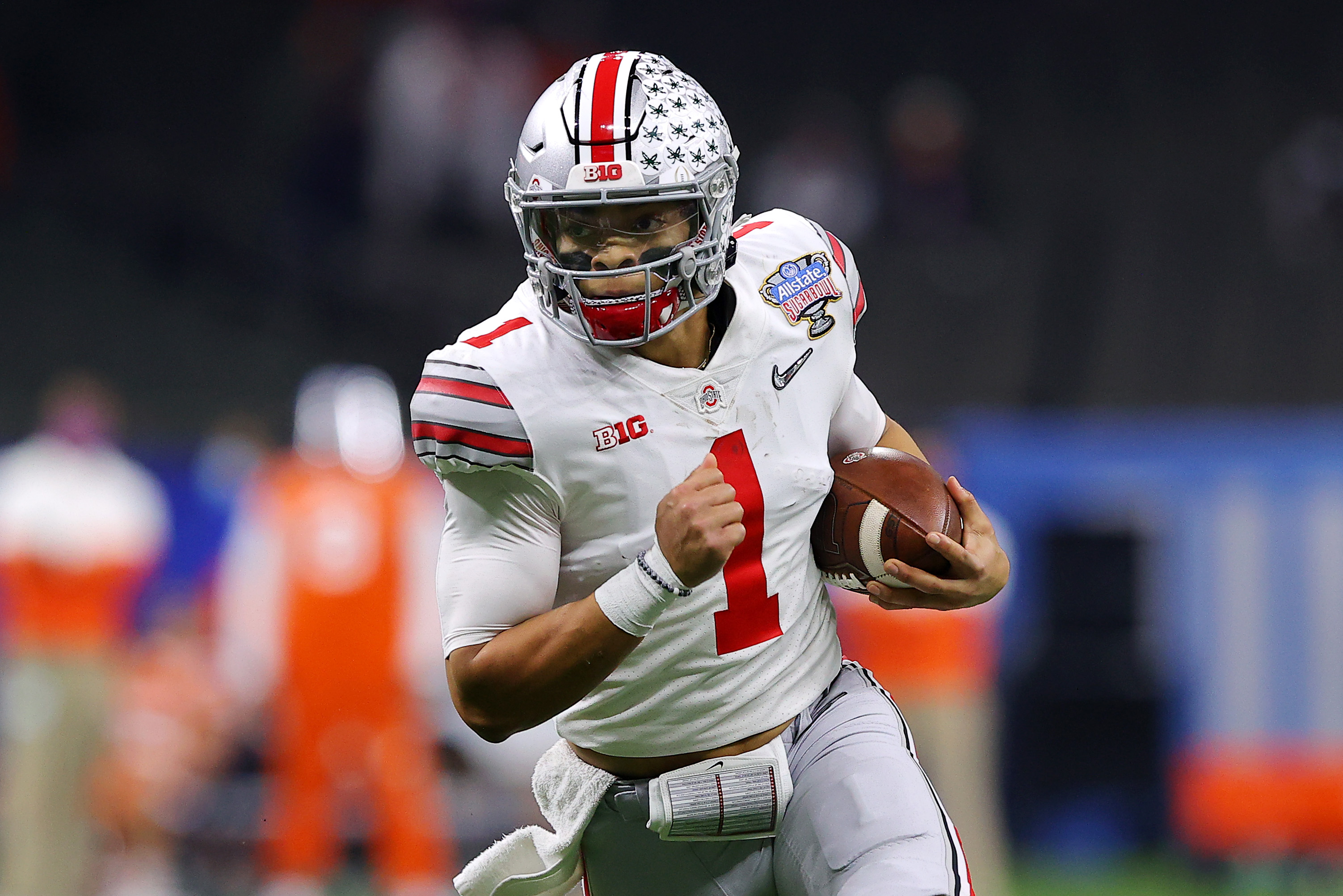Justin Fields of the Ohio State Buckeyes runs with the ball in the first half against the Clemson Tigers during the College Football Playoff semifinal game at the Allstate Sugar Bowl at Mercedes-Benz Superdome on January 01, 2021 in New Orleans, Louisiana.