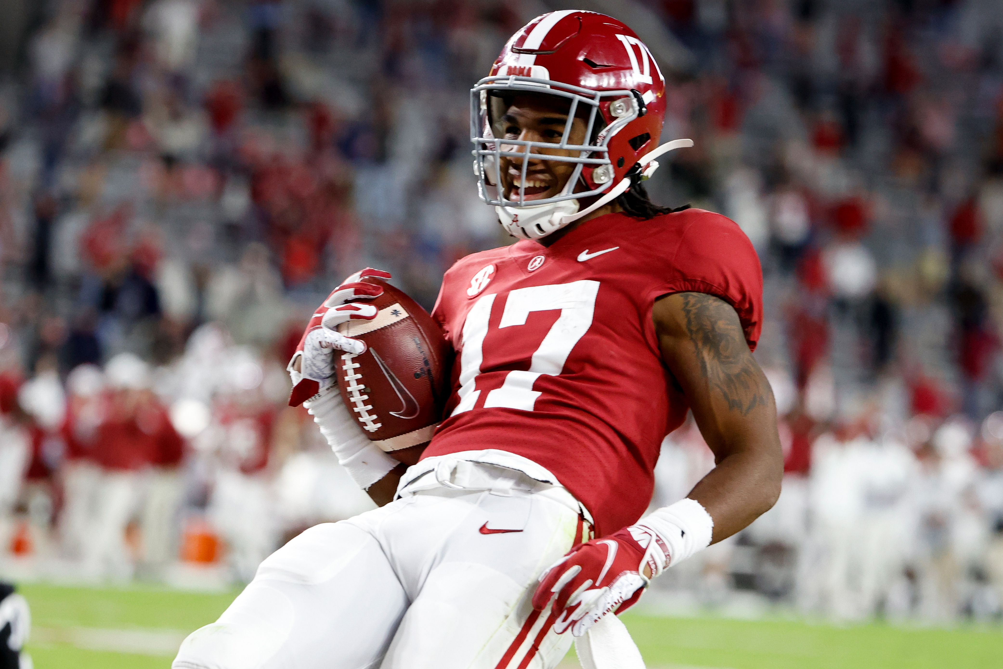 Jaylen Waddle of the Alabama Crimson Tide celebrates running in a touchdown in the seond half against the Georgia Bulldogs at Bryant-Denny Stadium on October 17, 2020 in Tuscaloosa, Alabama.