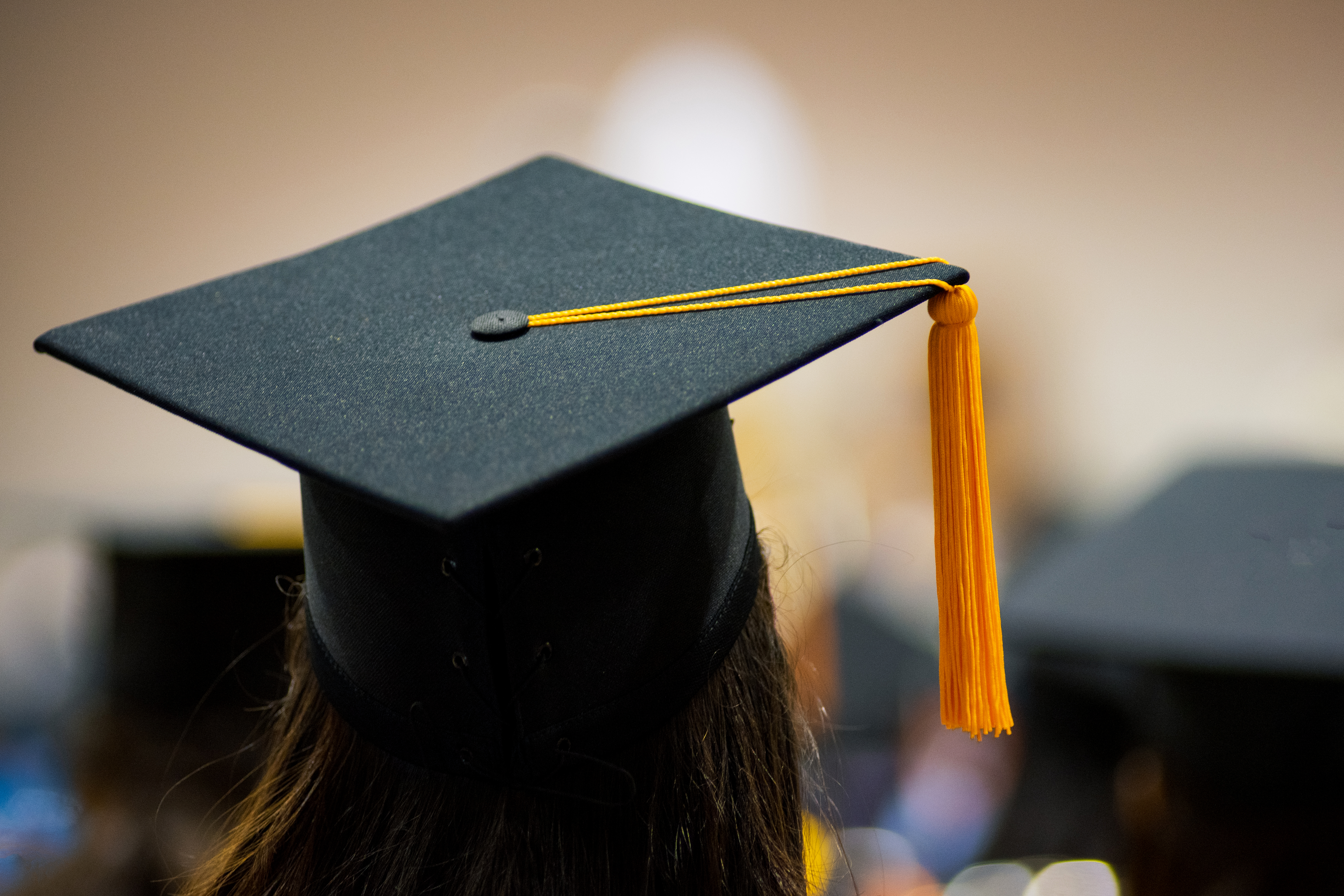 the back of the head of a woman wearing a mortarboard