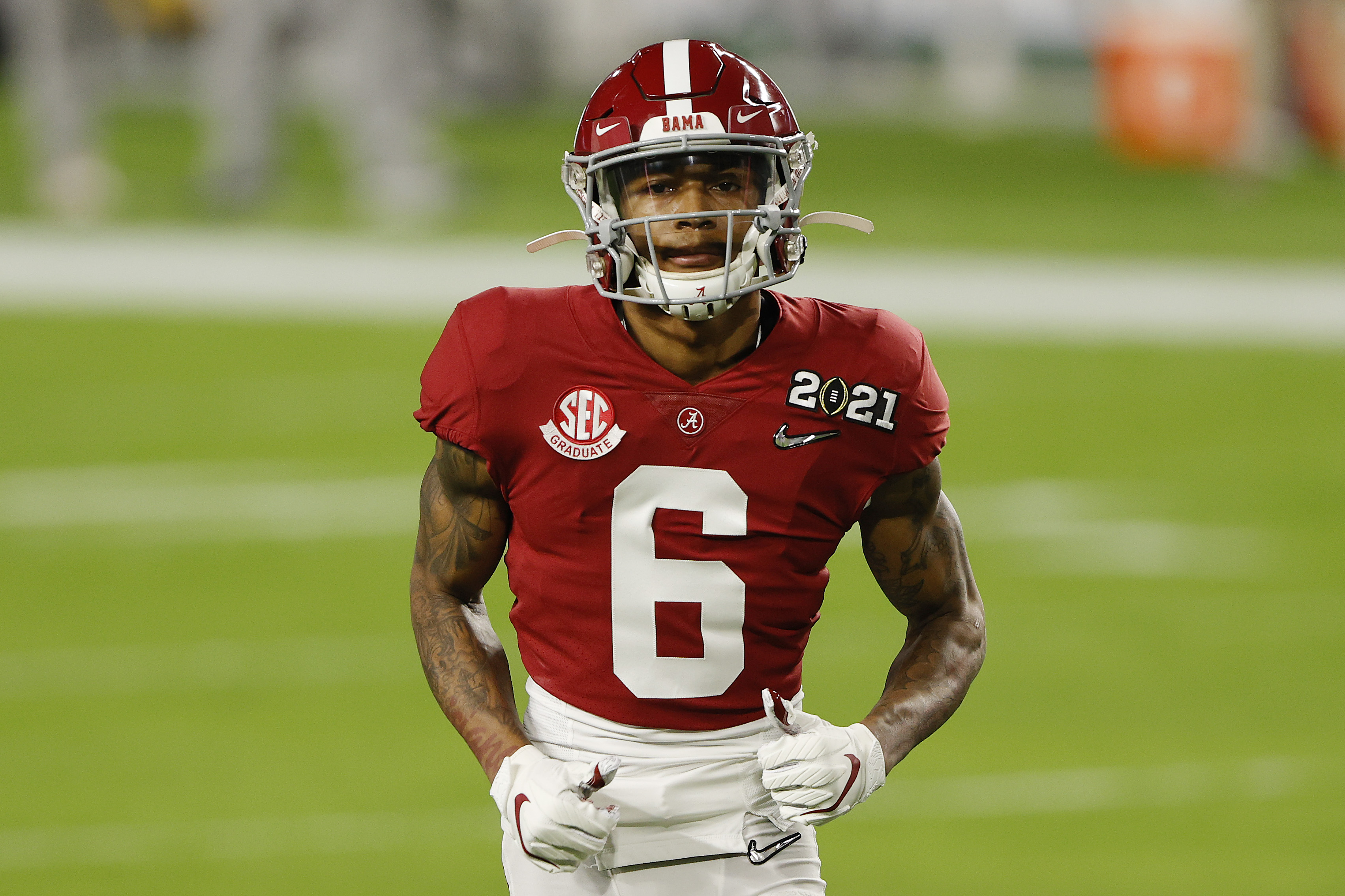 DeVonta Smith #6 of the Alabama Crimson Tide warms up prior to the College Football Playoff National Championship game against the Ohio State Buckeyes at Hard Rock Stadium on January 11, 2021 in Miami Gardens, Florida.