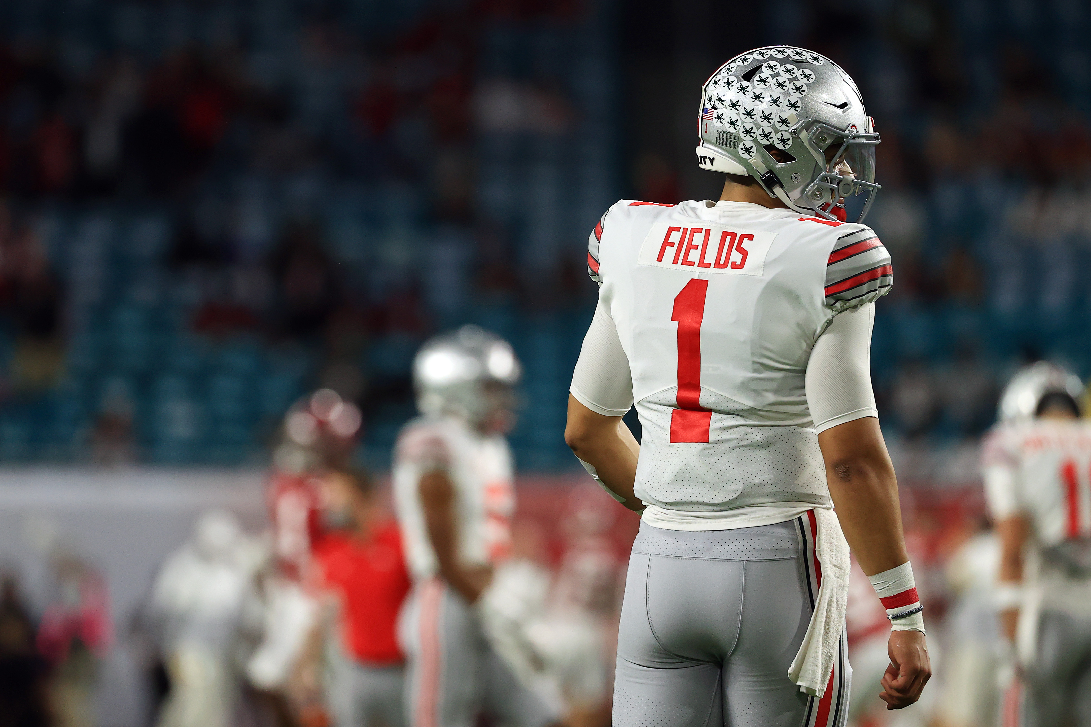 Justin Fields #1 of the Ohio State Buckeyes looks on prior to the College Football Playoff National Championship game against the Alabama Crimson Tide at Hard Rock Stadium on January 11, 2021 in Miami Gardens, Florida.