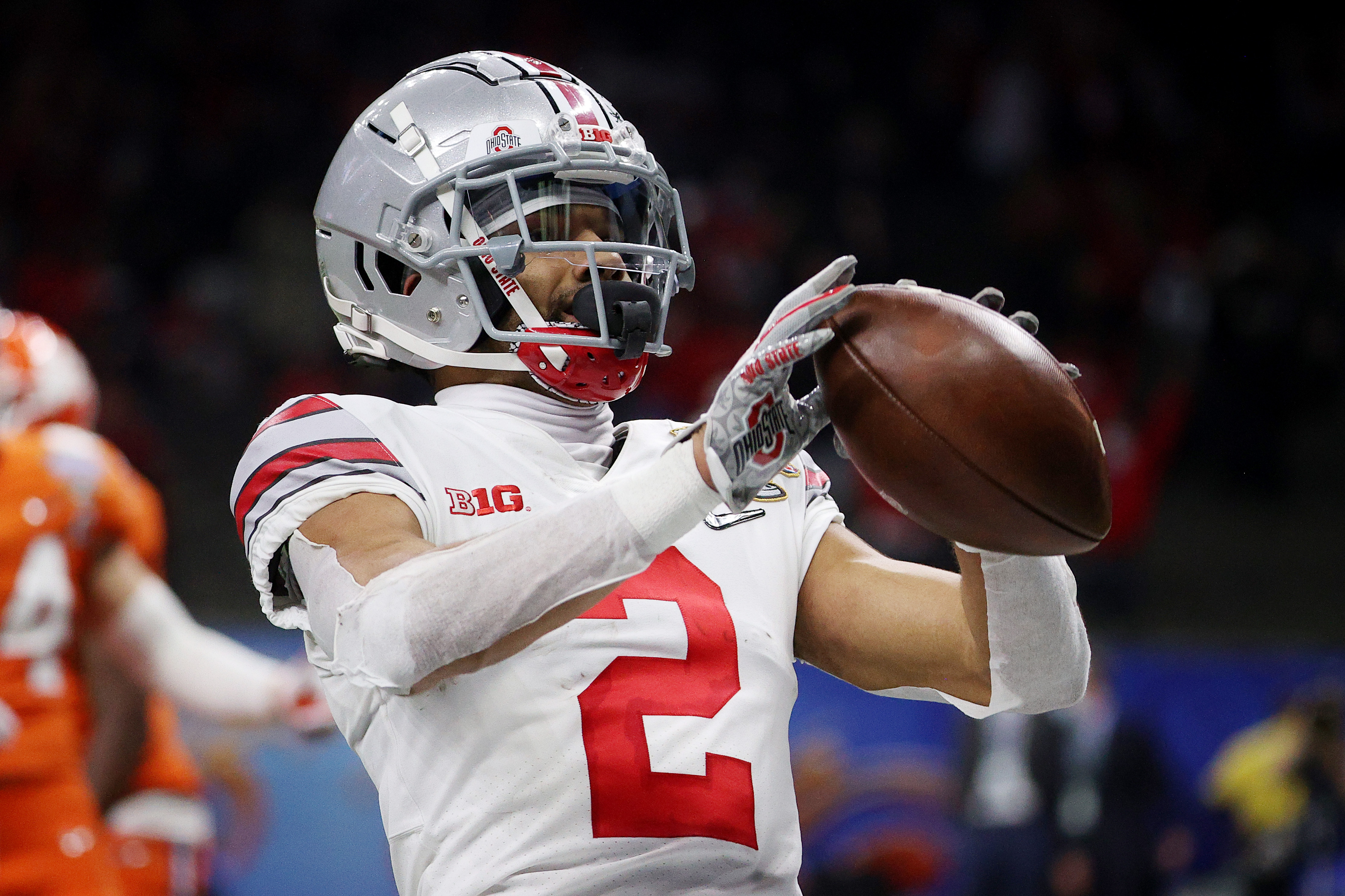 Chris Olave of the Ohio State Buckeyes reacts after his touchdown catch against the Clemson Tigers in the third quarter during the College Football Playoff semifinal game at the Allstate Sugar Bowl at Mercedes-Benz Superdome on January 01, 2021 in New Orleans, Louisiana.