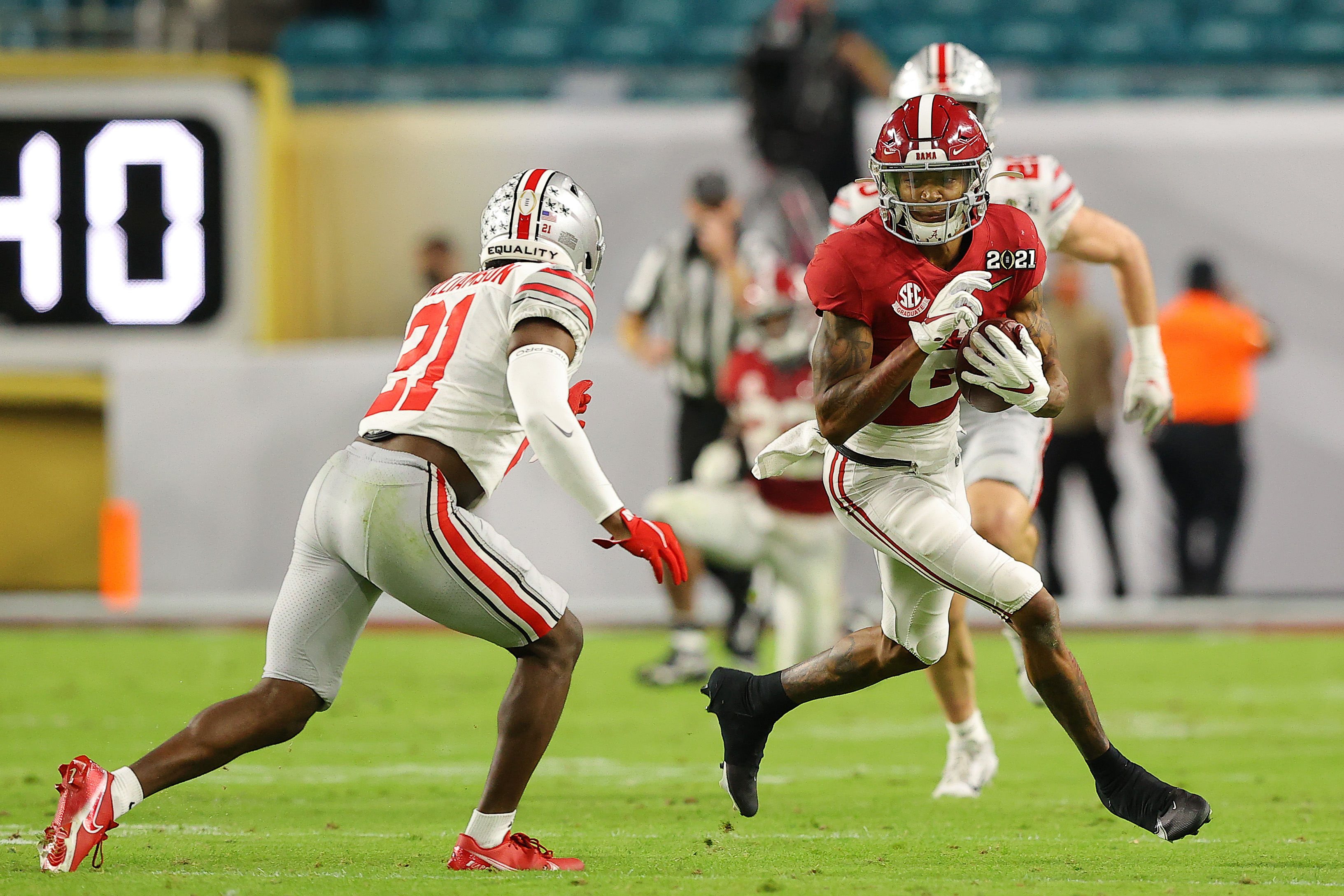 DeVonta Smith #6 of the Alabama Crimson Tide rushes ahead of Marcus Williamson #21 of the Ohio State Buckeyes during the second quarter of the College Football Playoff National Championship game at Hard Rock Stadium on January 11, 2021 in Miami Gardens, Florida.