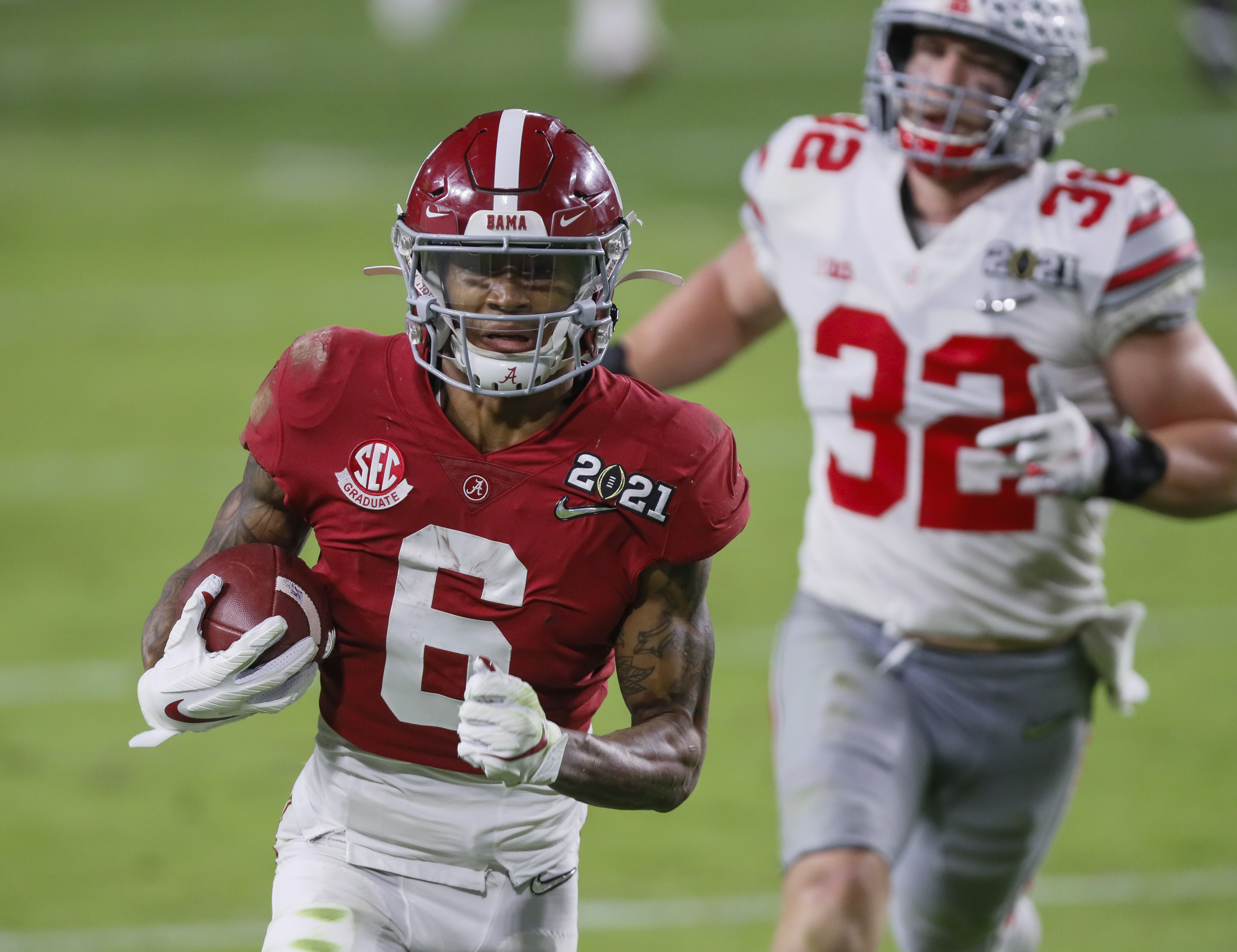 Alabama Crimson Tide wide receiver DeVonta Smith (6) catches a 42-yard touchdown behind Ohio State Buckeyes linebacker Tuf Borland (32) during the second quarter of the College Football Playoff National Championship at Hard Rock Stadium in Miami Gardens, Fla.