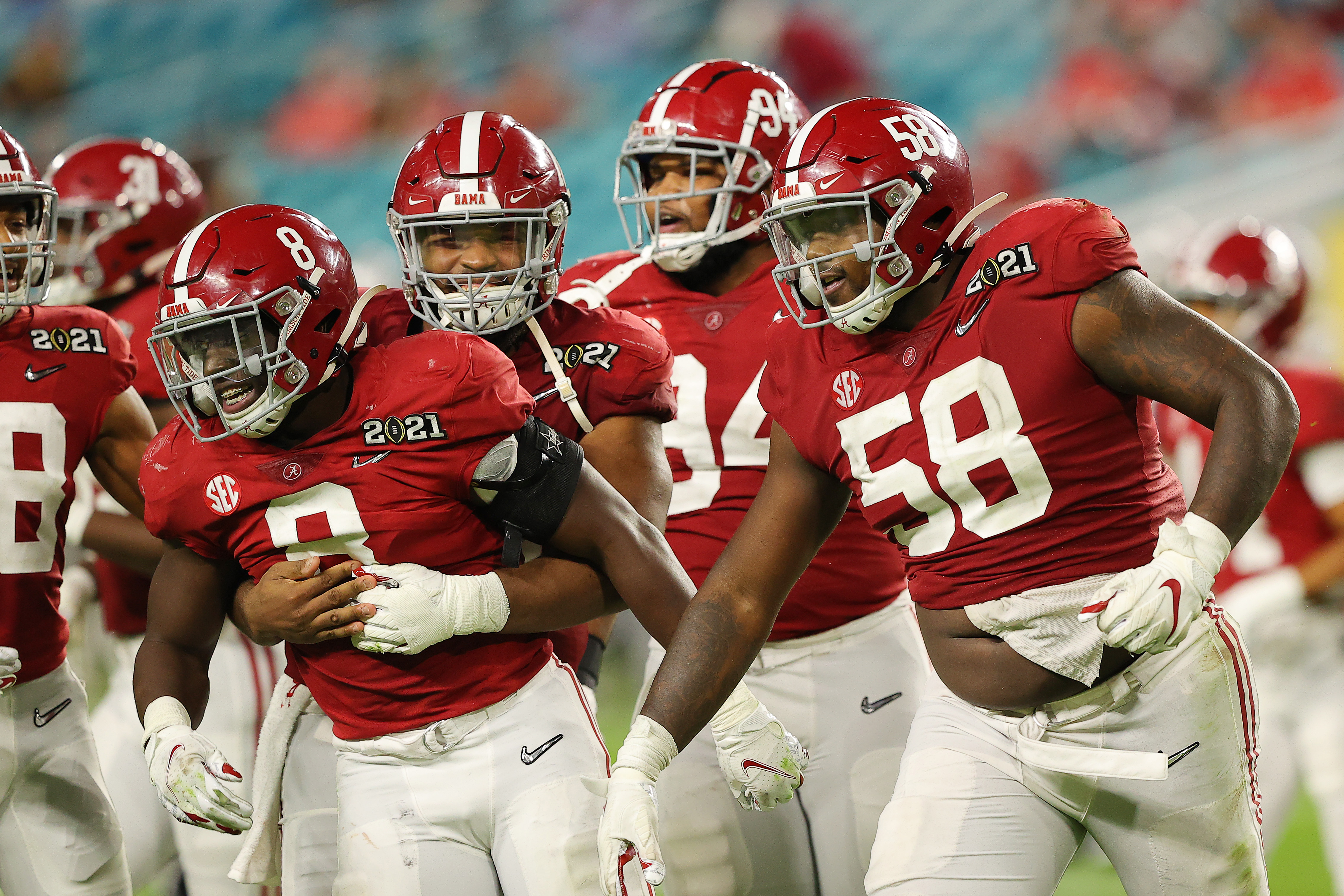 Christian Barmore of the Alabama Crimson Tide celebrates a defensive stop alongside Christian Harris during the third quarter of the College Football Playoff National Championship game against the Ohio State Buckeyes at Hard Rock Stadium on January 11, 2021 in Miami Gardens, Florida.