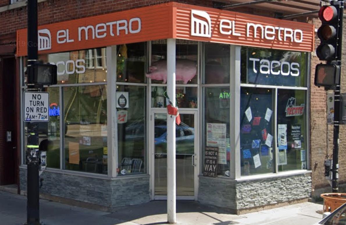 "A corner restaurant with orange awning that reads ""El Metro."""