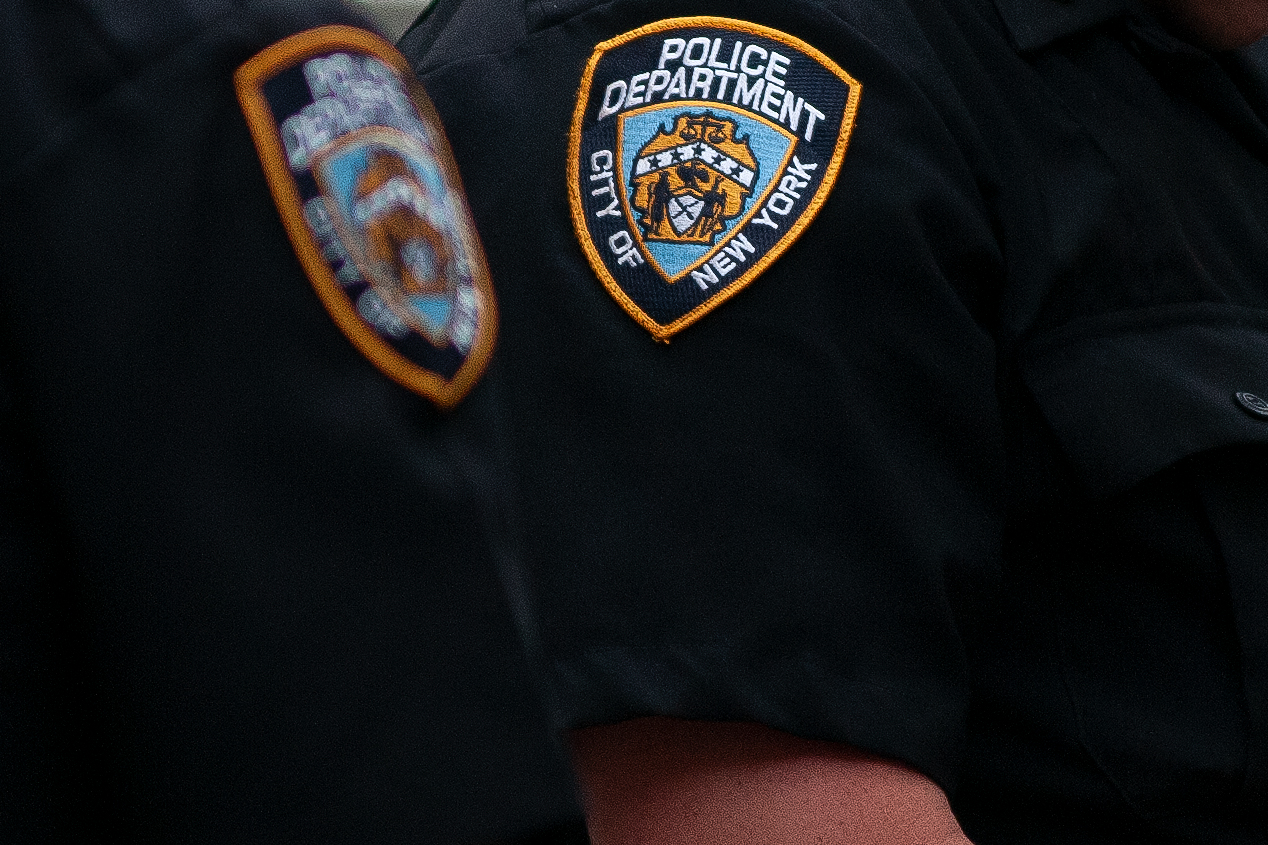 Two NYPD officers stand guard in lower Manhattan.