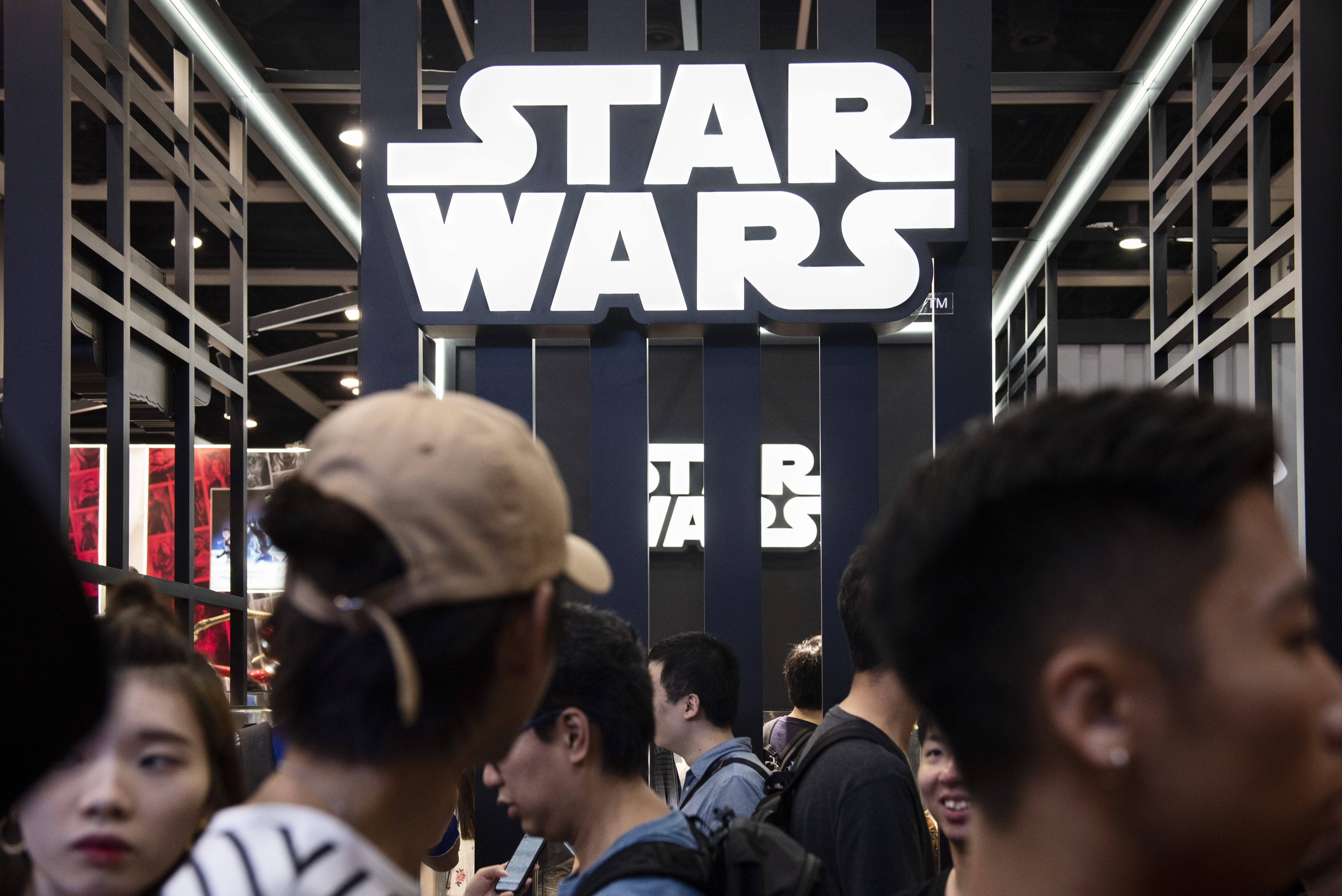 Visitors are seen at Disney's Star Wars booth during the Ani...