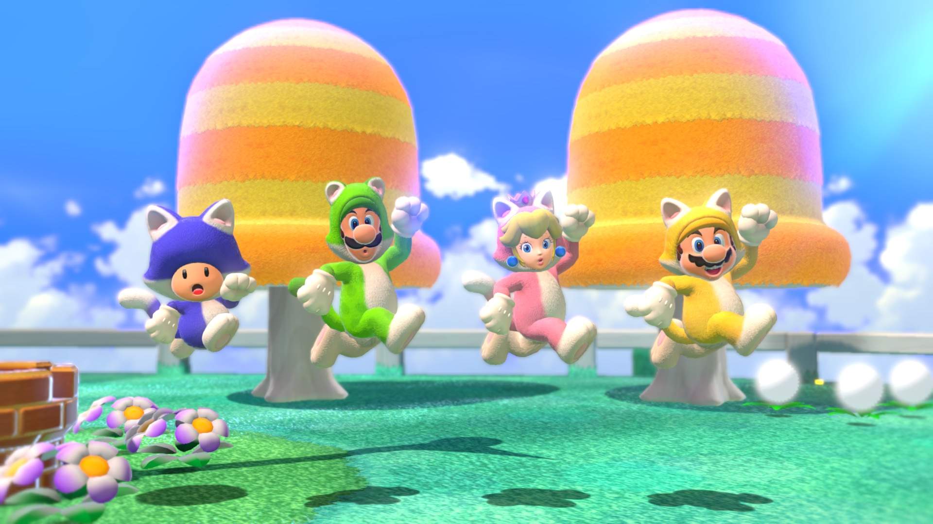 Toad, Luigi, Peach and Mario jump wearing cat suits in a screenshot from Super Mario 3D World