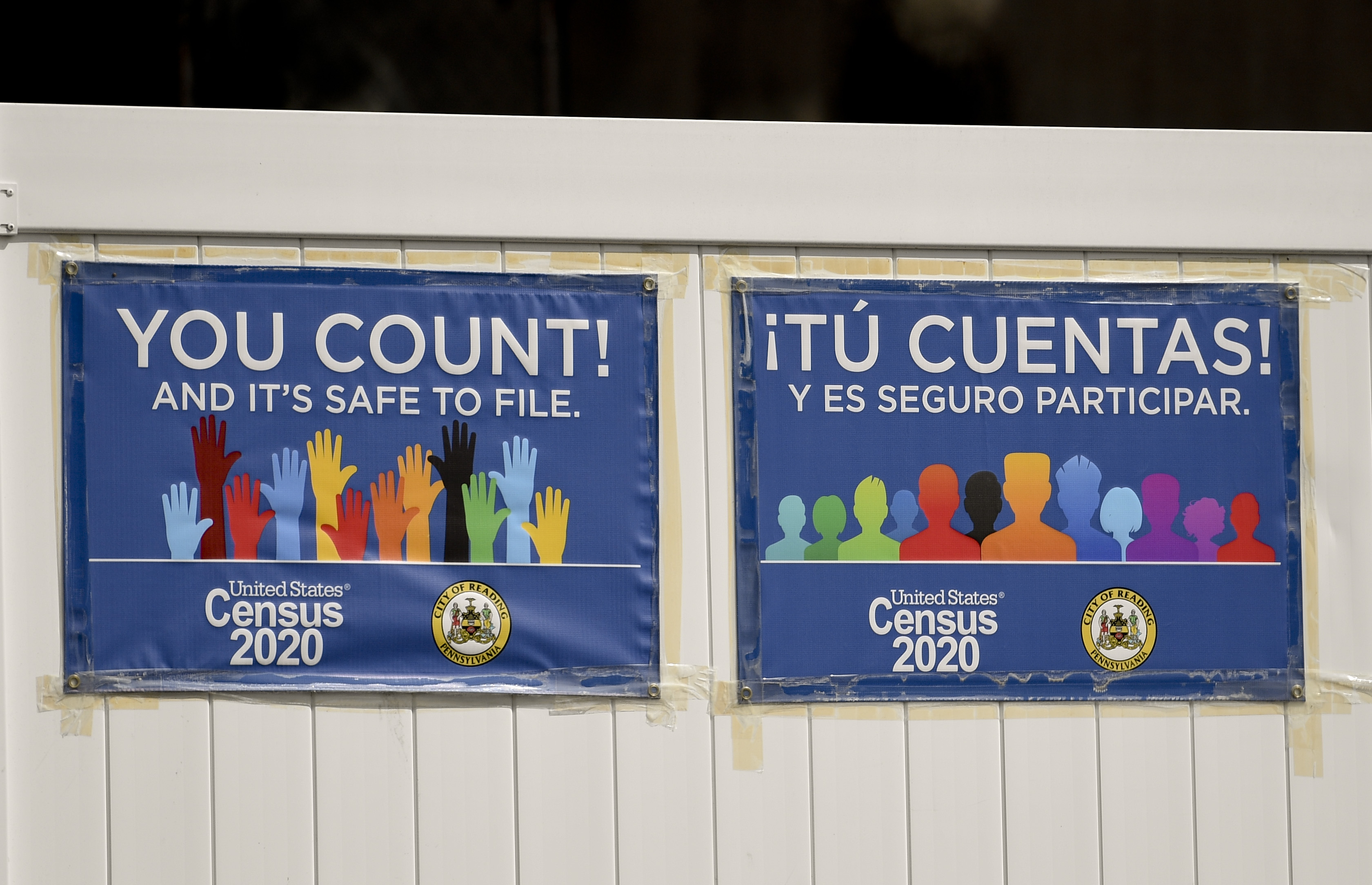 """The signs read, """"You Count! And it's safe to file. Census 2020."""""""