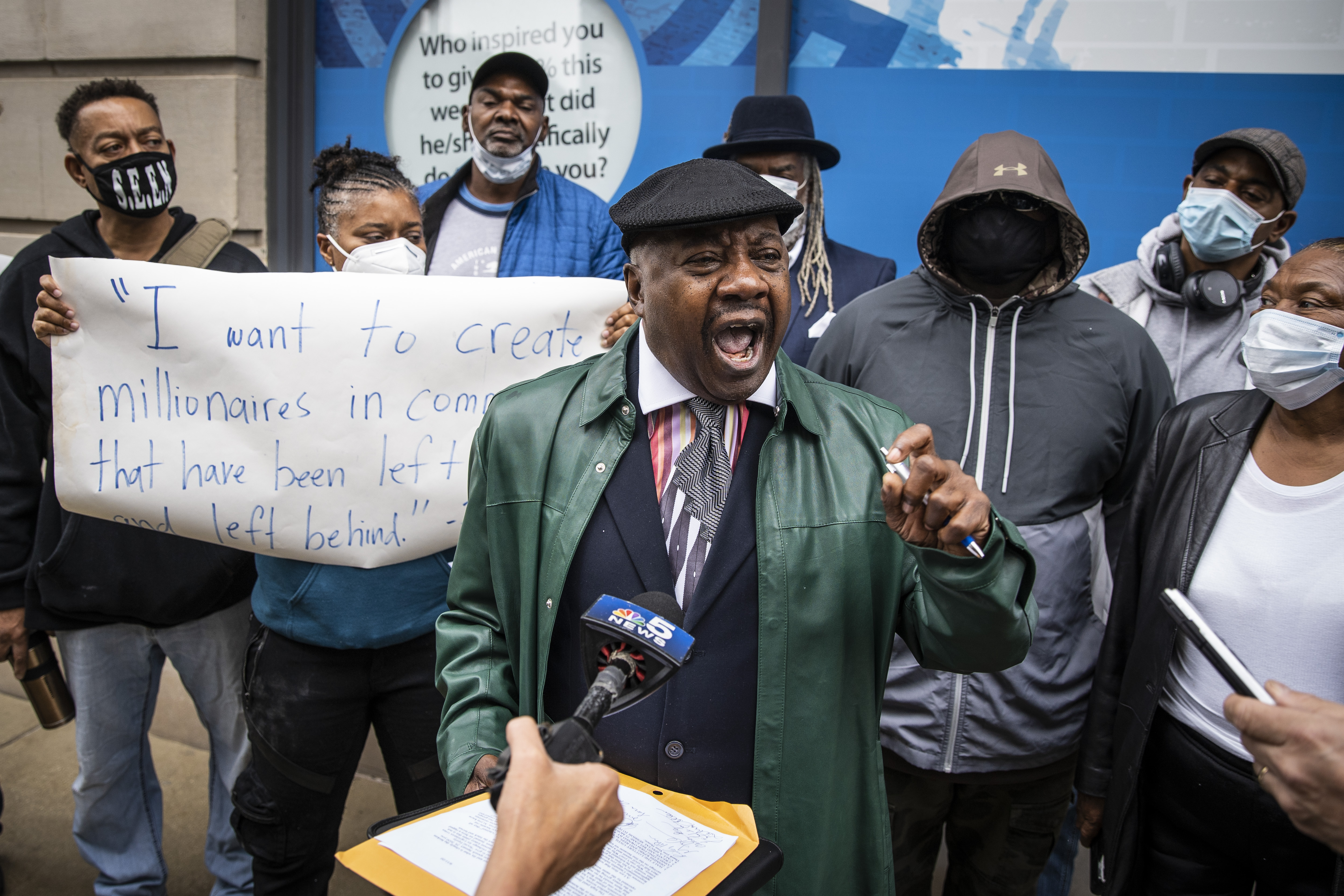 Former state Sen. Rickey Hendon protests in t the Loop — outside a building where Gov. J.B. Pritzker hosts an unrelated press conference — with Black and Latino social equity applicants who were denied for cannabis industry licenses in Illinois, Sept. 11, 2020.   Ashlee Rezin Garcia/Sun-Times