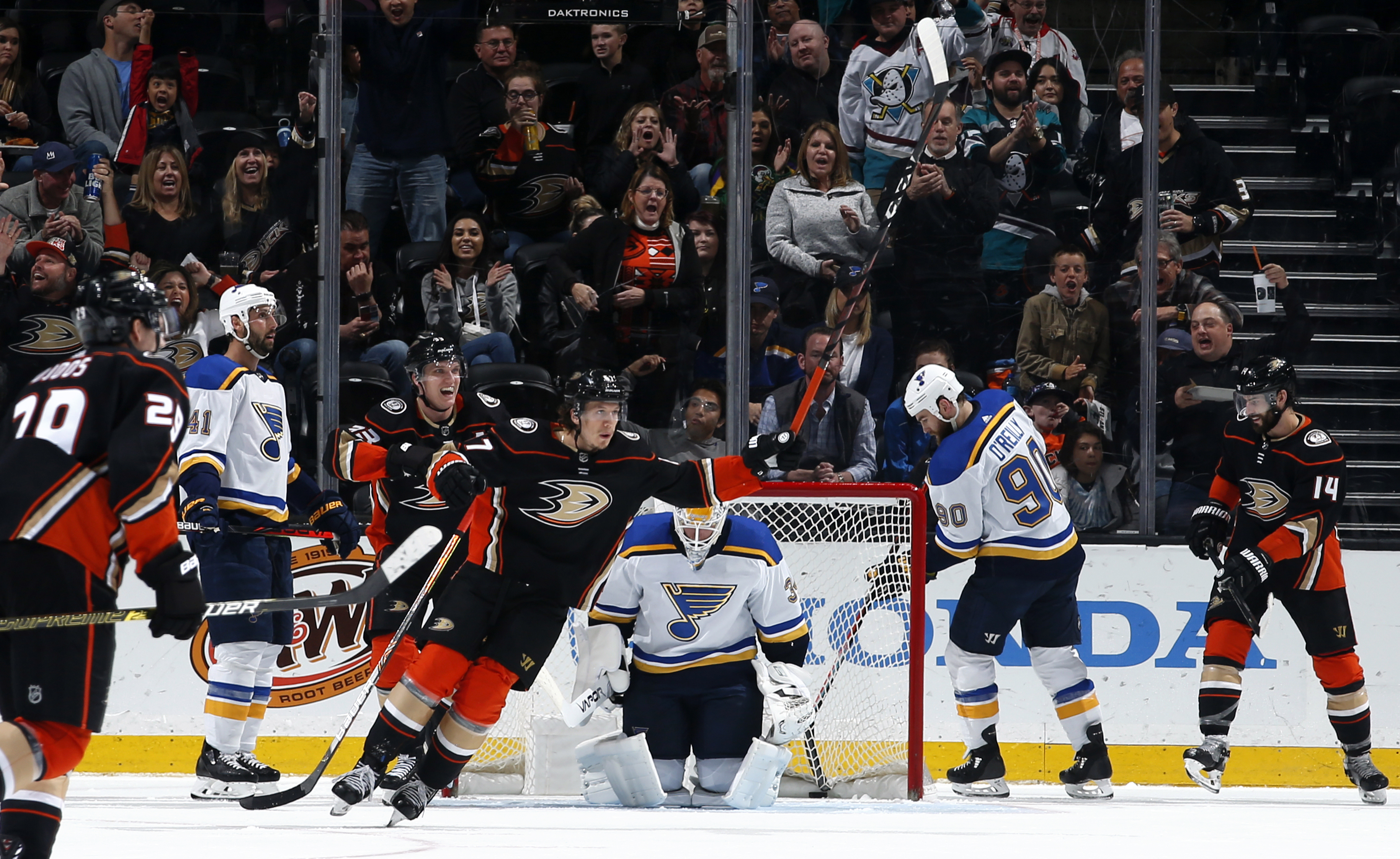 Rickard Rakell #67, Jakob Silfverberg #33, Christian Djoos #29, and Adam Henrique #14 of the Anaheim Ducks celebrate a second period goal against Jake Allen #34, Robert Bortuzzo #41, and Ryan O'Reilly #90 of the St. Louis Blues during the game at Honda Center on March 11, 2020 in Anaheim, California.