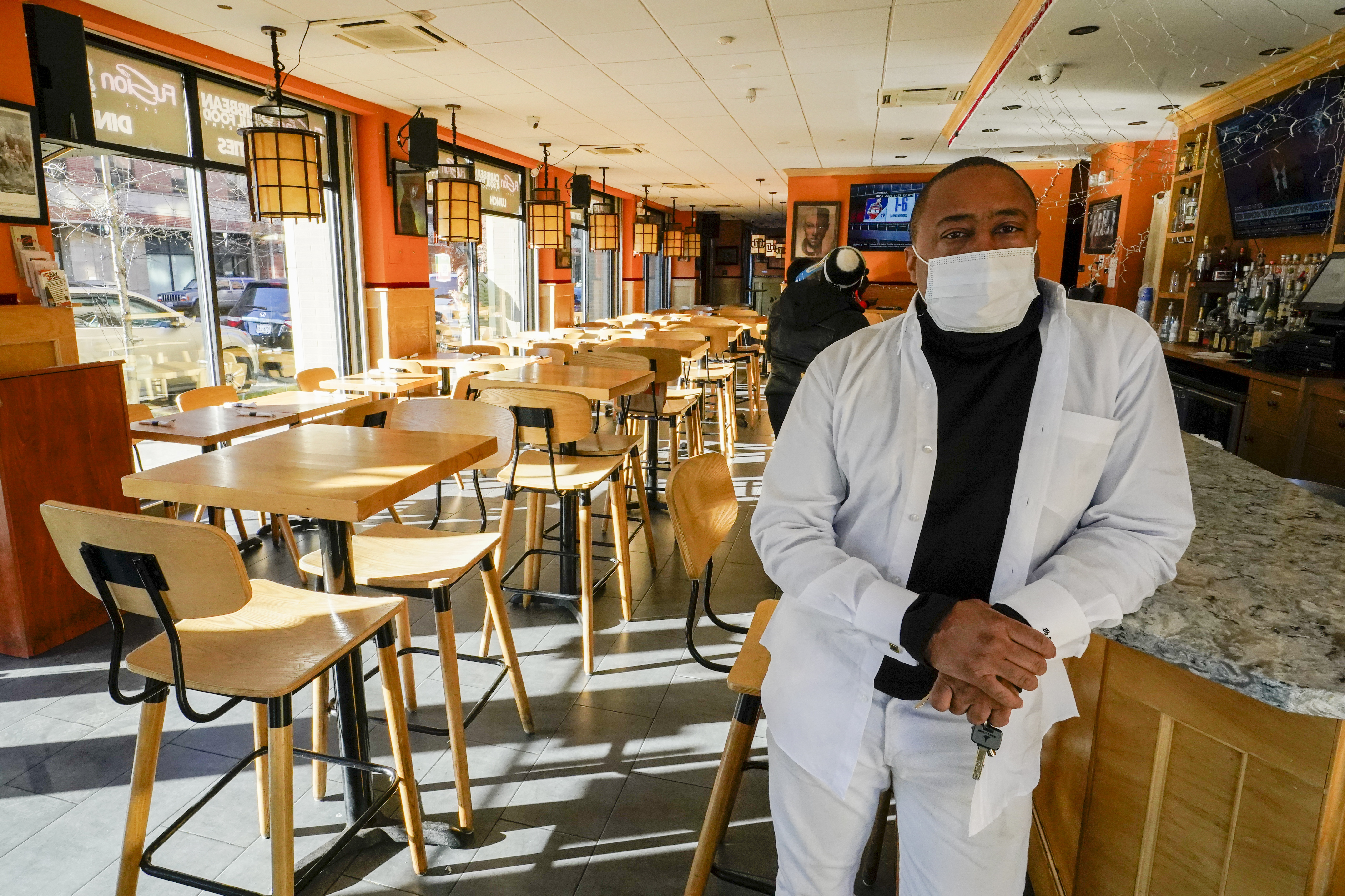Andrew Walcott, owner of Fusion East Caribbean & Soul Food restaurant, poses for a photo at the restaurant in East New York neighborhood of the Brooklyn borough of New York, Thursday, Jan. 7, 2021.