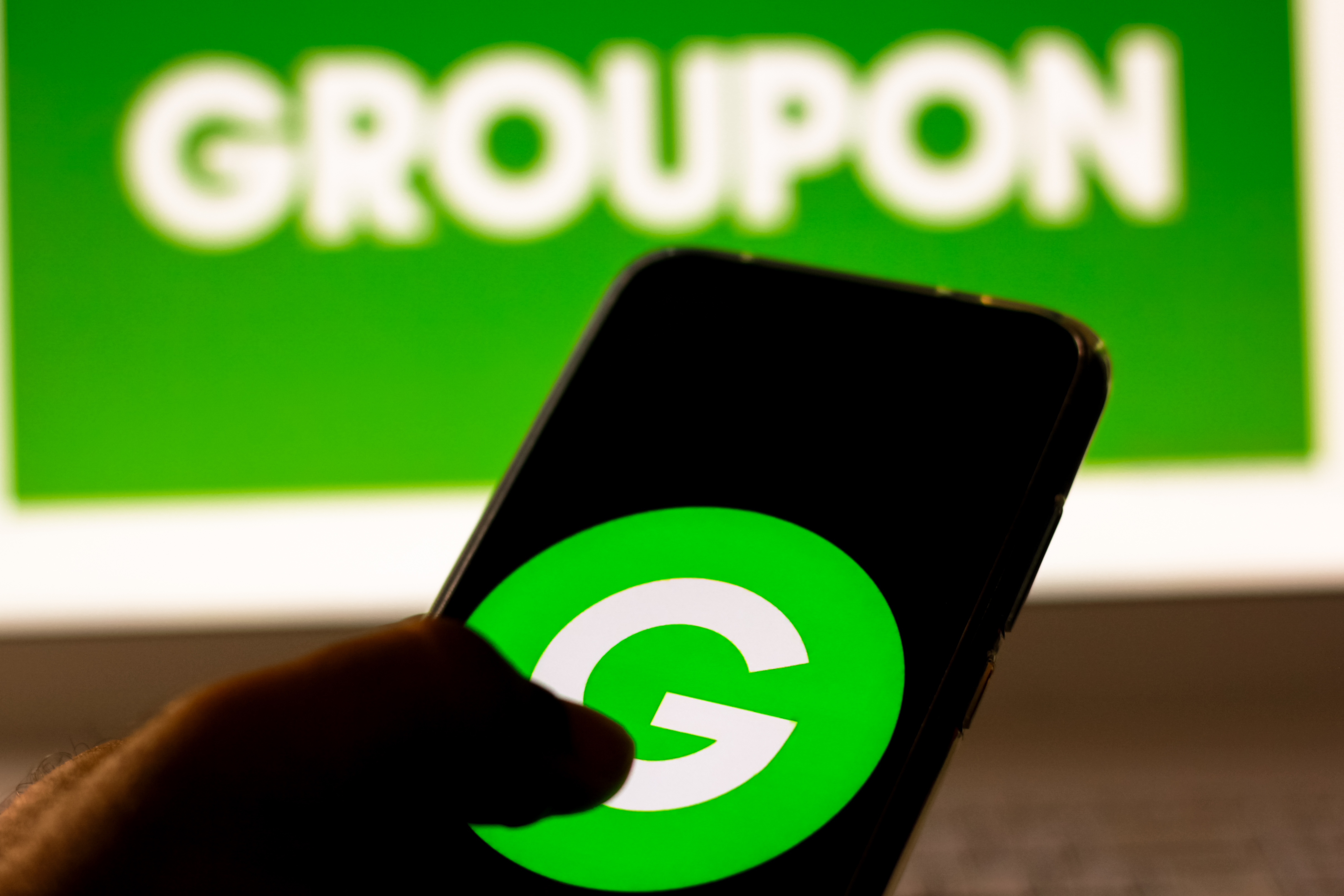 In this photo illustration the Groupon logo is displayed on...