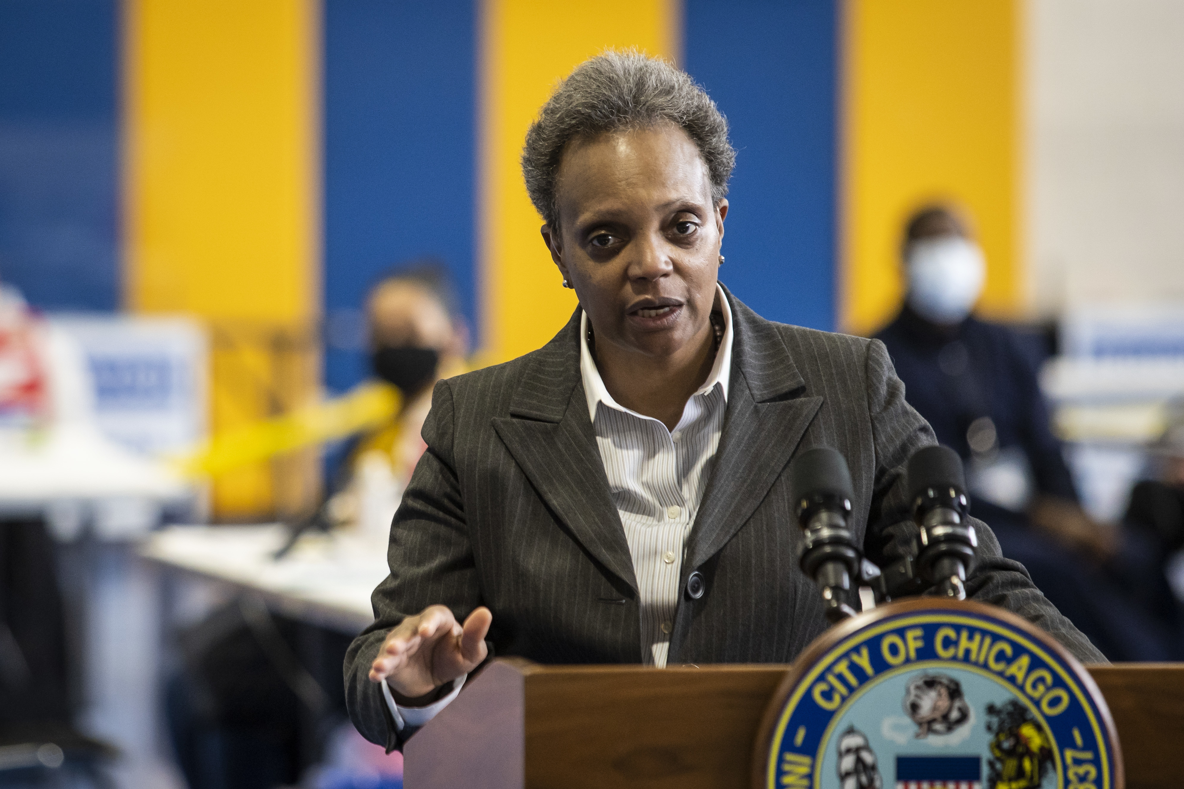 Mayor Lori Lightfoot talks about COVID-19 vaccinations Thursday at Richard J. Daley College, the first of six mass distribution sites opening in the city.