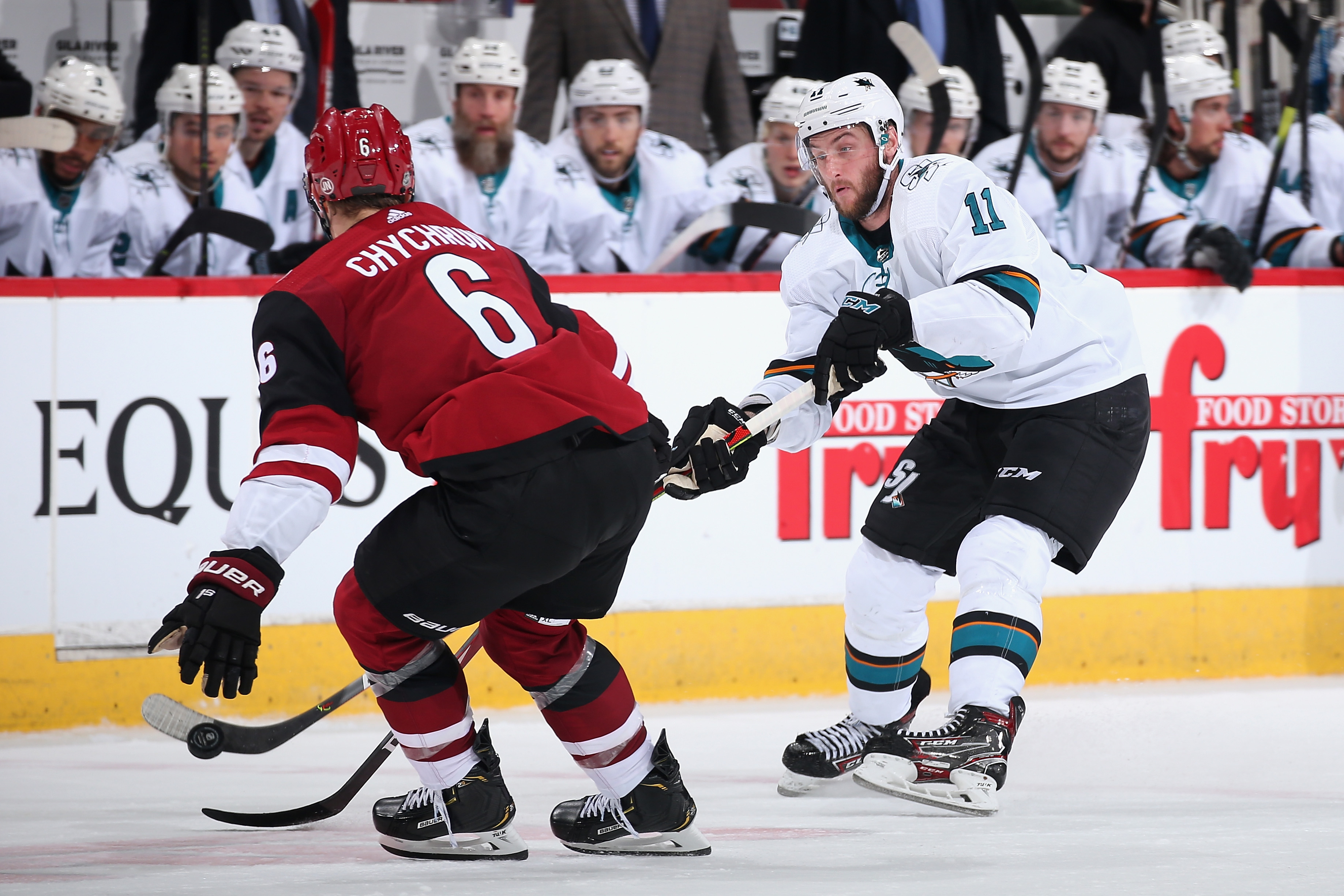Stefan Noesen #11 of the San Jose Sharks moves the puck past Jakob Chychrun #6 of the Arizona Coyotes during the third period of the NHL game at Gila River Arena on January 14, 2020 in Glendale, Arizona. The Coyotes defeated the Sharks 6-3.