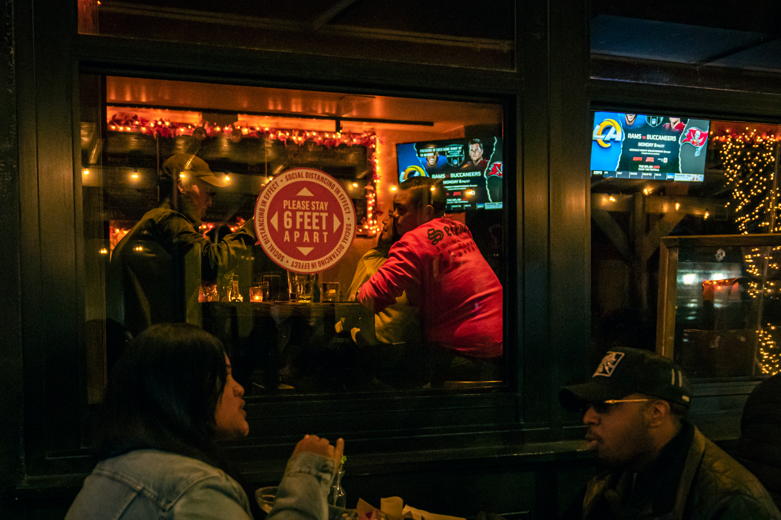 People eat at a sports bar in Greenwich Village, Nov. 20, 2020.
