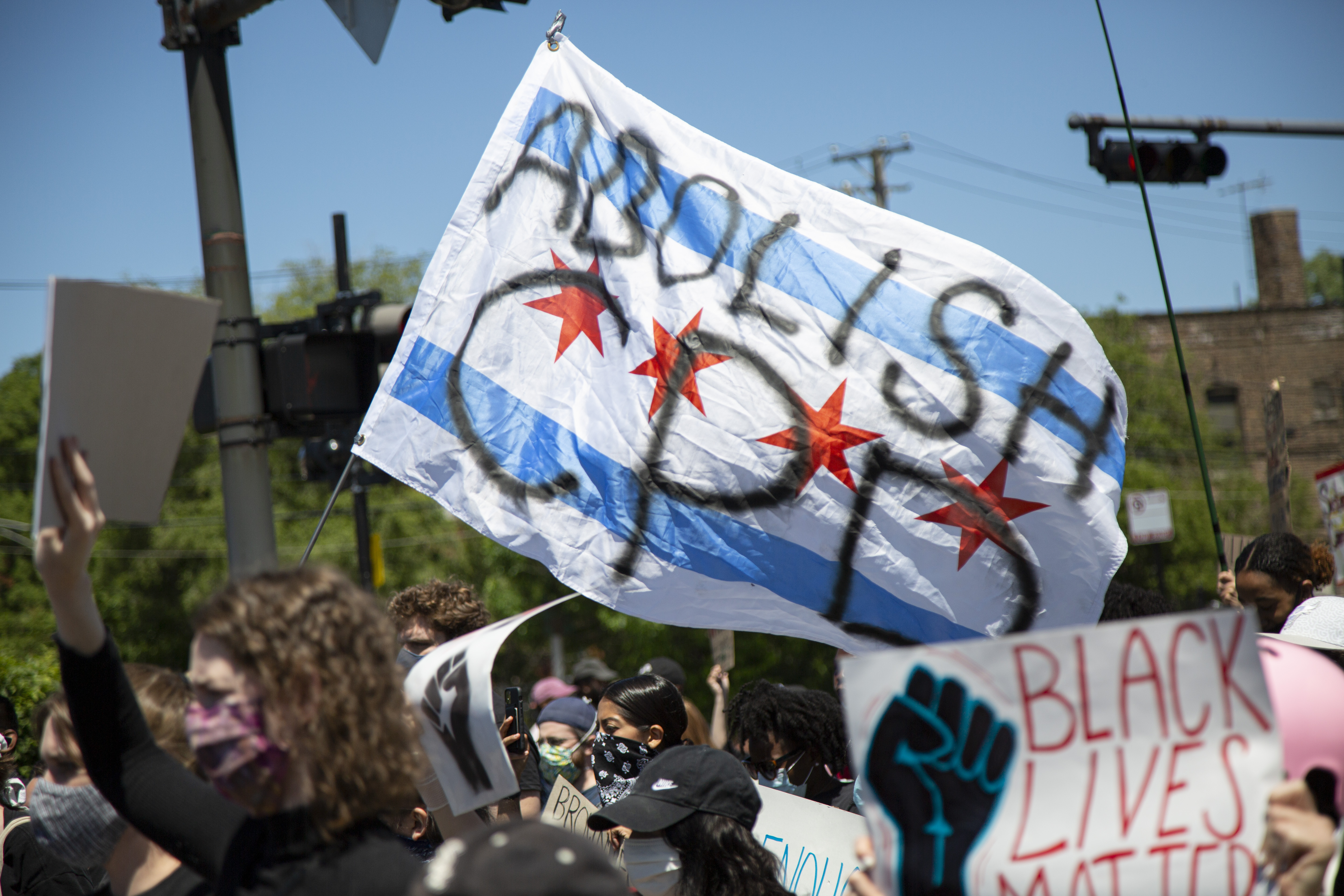 """Protesters waved an """"Abolish CPD"""" flag on East 63rd Street in Woodlawn last June."""