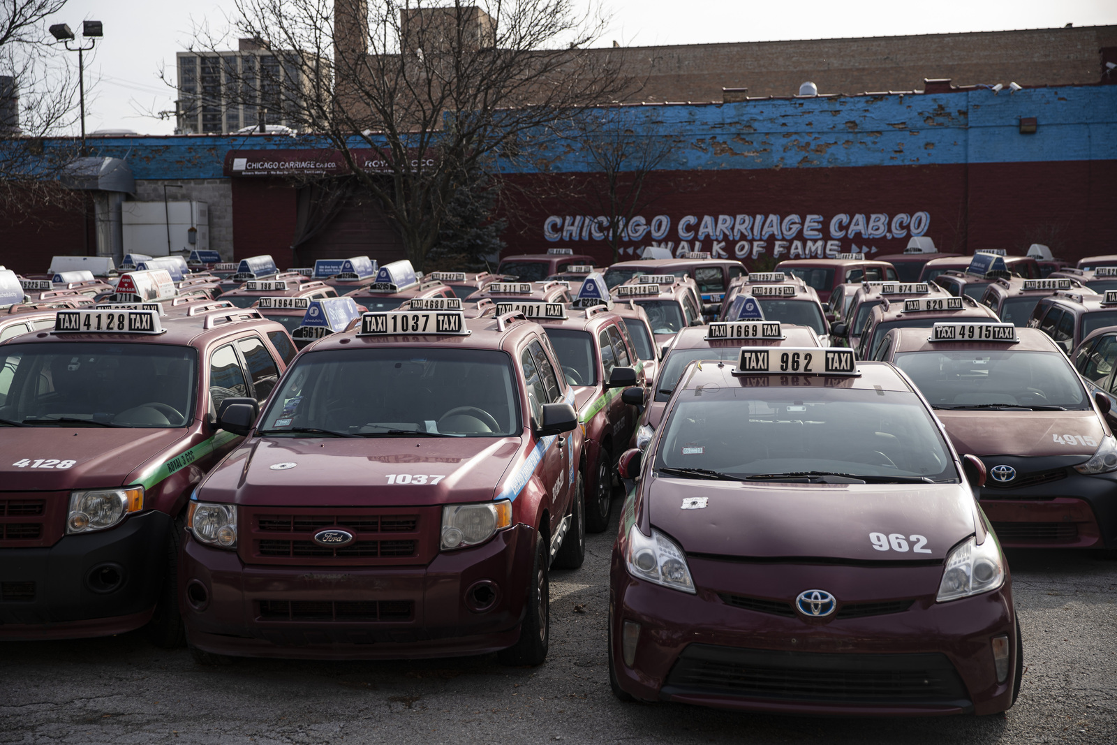 Cabs that were part of Symon Garber's taxicab empire sit idle at his Chicago Carriage Cab Co. headquarters at 2617 S. Wabash Ave. He has sold the property to a developer, and no one is even answering the phones there any longer.