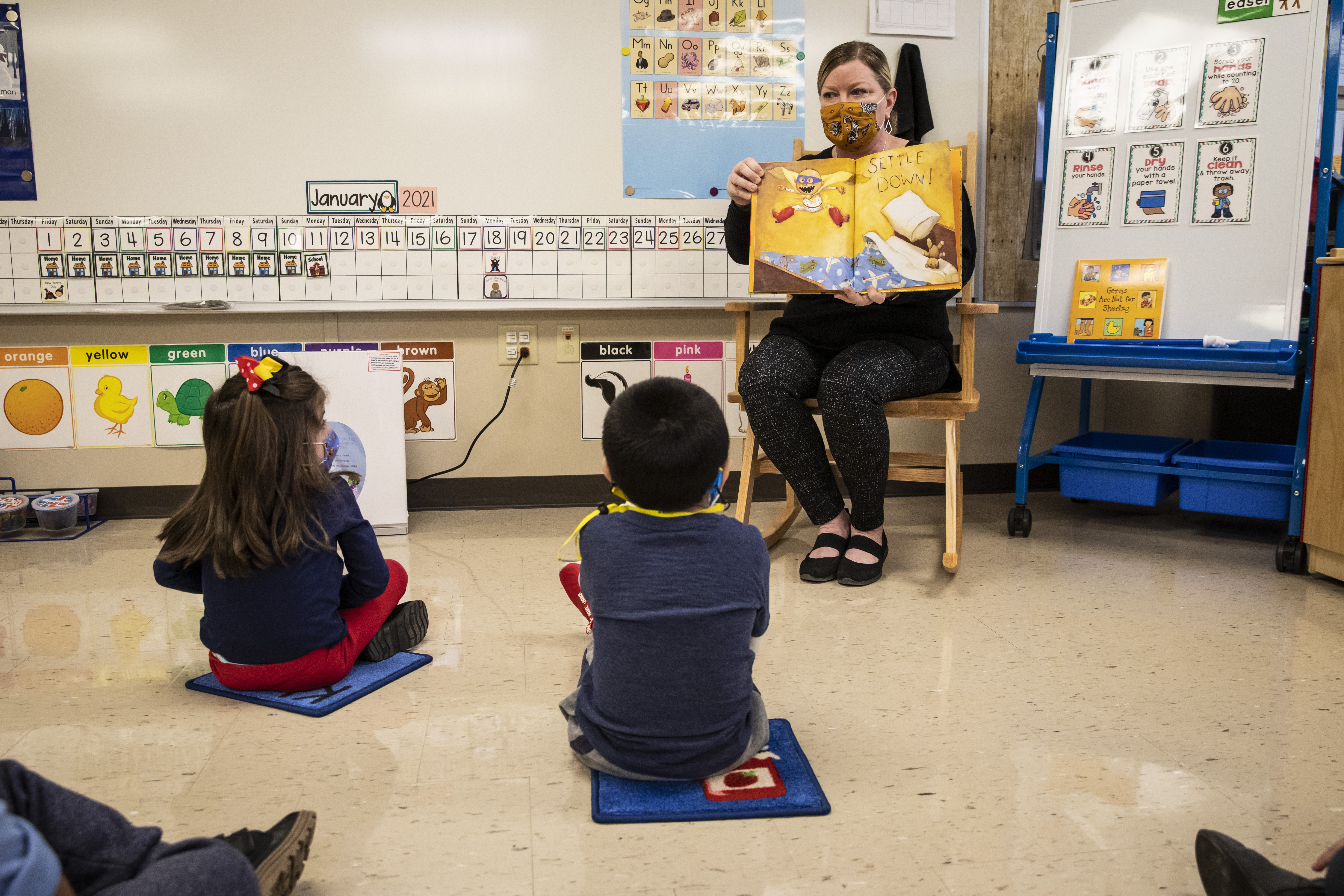 Pre-kindergarten teacher Angela Panush reads a story to her students at Dawes Elementary on Monday.