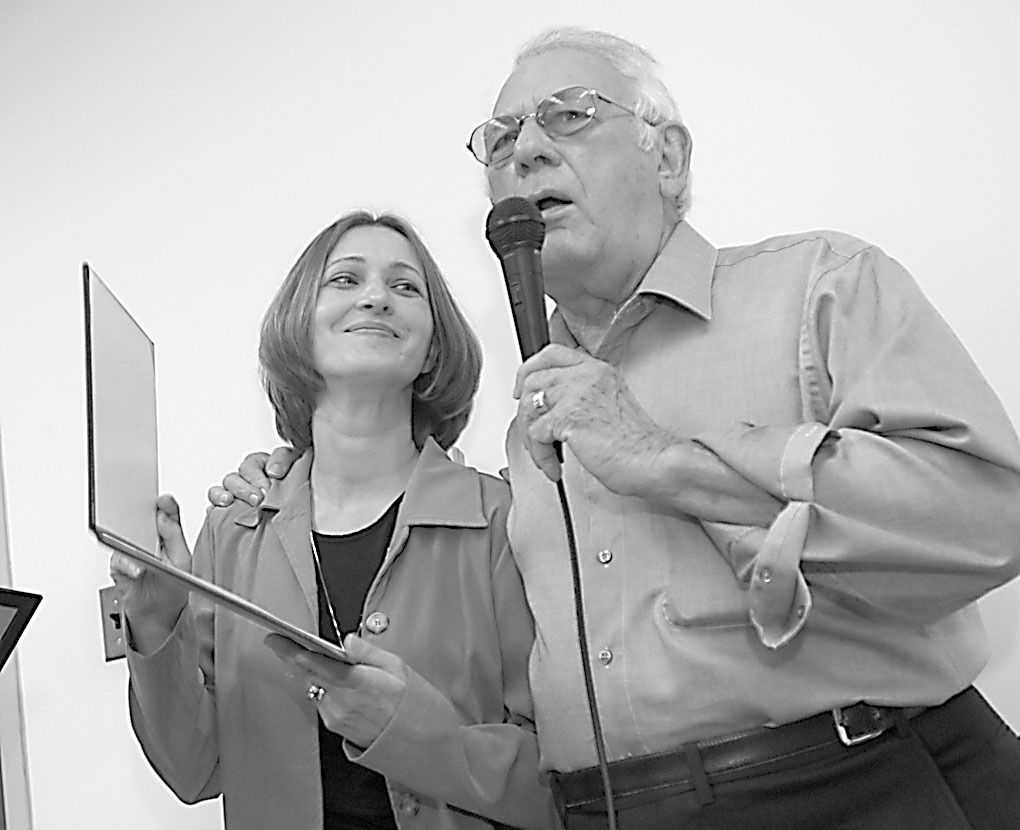 State Rep. Ralph Capparelli in 2004, with Rosa DiFronzo, left, who was being honored for helping stop a senior citizen from being defrauded.